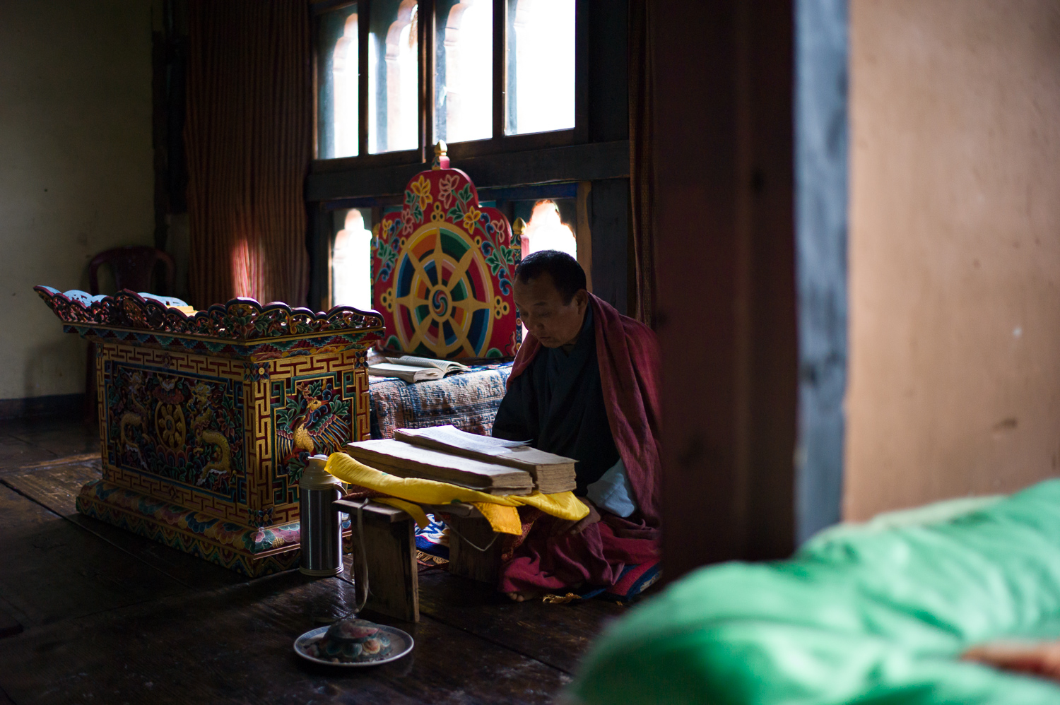 Many people have a small temple room in their house where they pray daily. Farmer's House, Paro