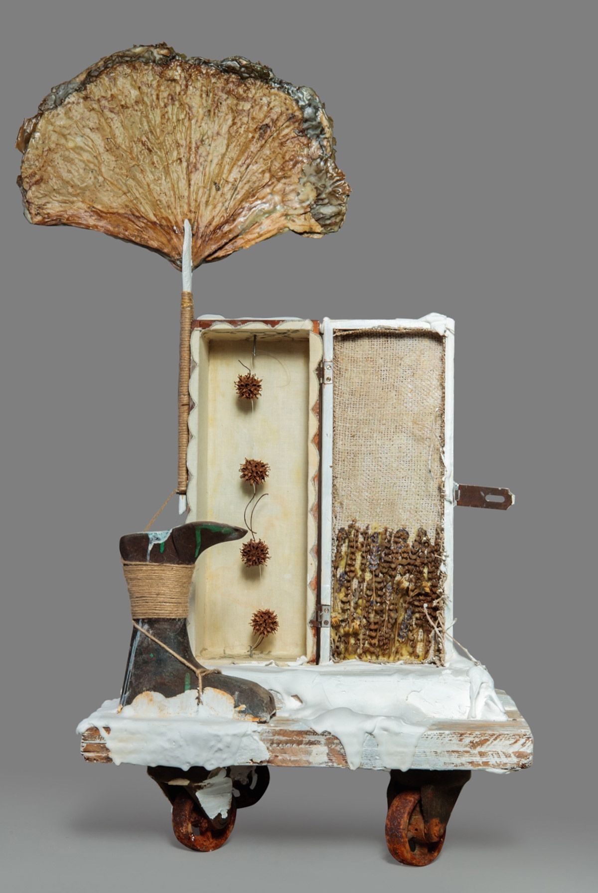 Out of the Earth  (Front) Found objects, burlap, dried plant material, plaster, white paint, encaustic, graphite, twine, glue and nails 36.5 x 18 x 16.5 in/92.7 x 45.7 x 41.9 cm