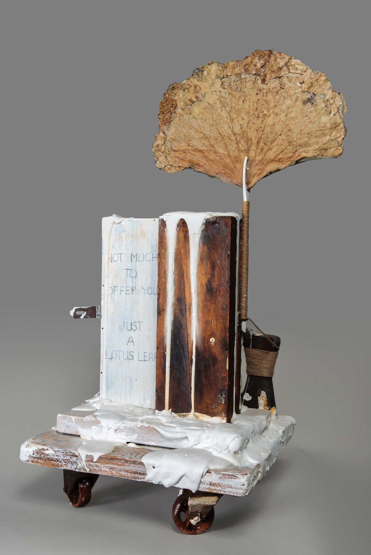Out of the Earth  (Back)Found objects, burlap, dried plant material, plaster, white paint, encaustic, graphite, twine, glue, and nails 36.5 x 18 x 16.5 in/92.7 x 45.7 x 41.9 cm
