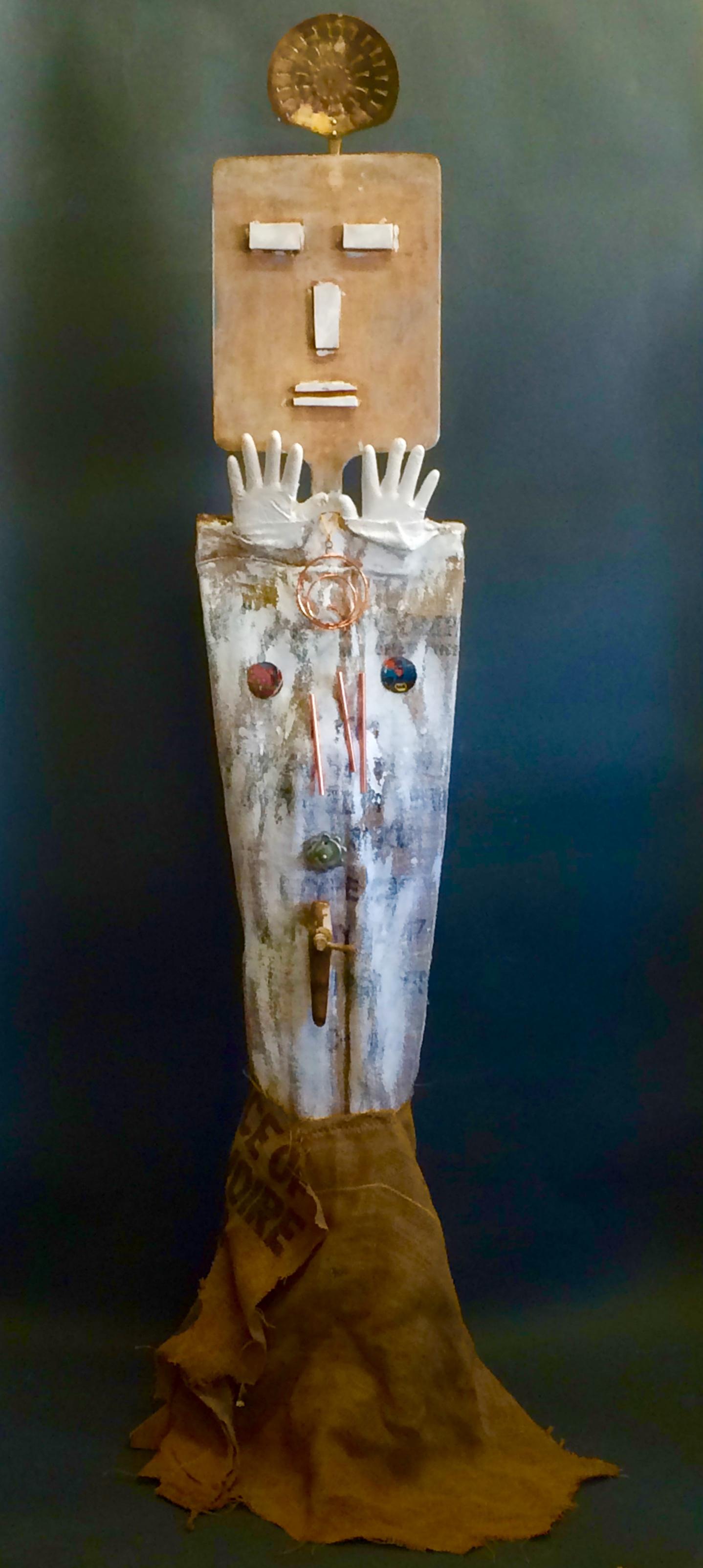 Sun God  Found objects, burlap, nails, gesso, vinyl glove and glue 97 x 27 x 27 in/ 246.3 x 68.5 x 68.5 cm