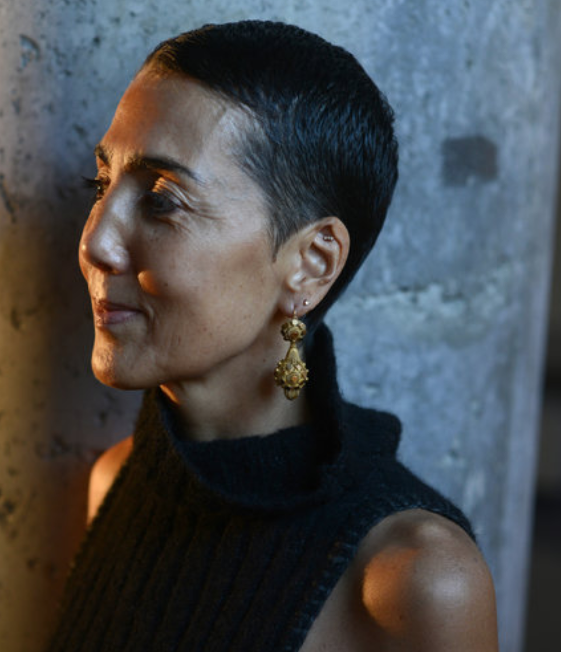 Elizabeth Yoshida - stylist from NYC. Shows how multipiercings look chic at 56. Contemporary jewellery style