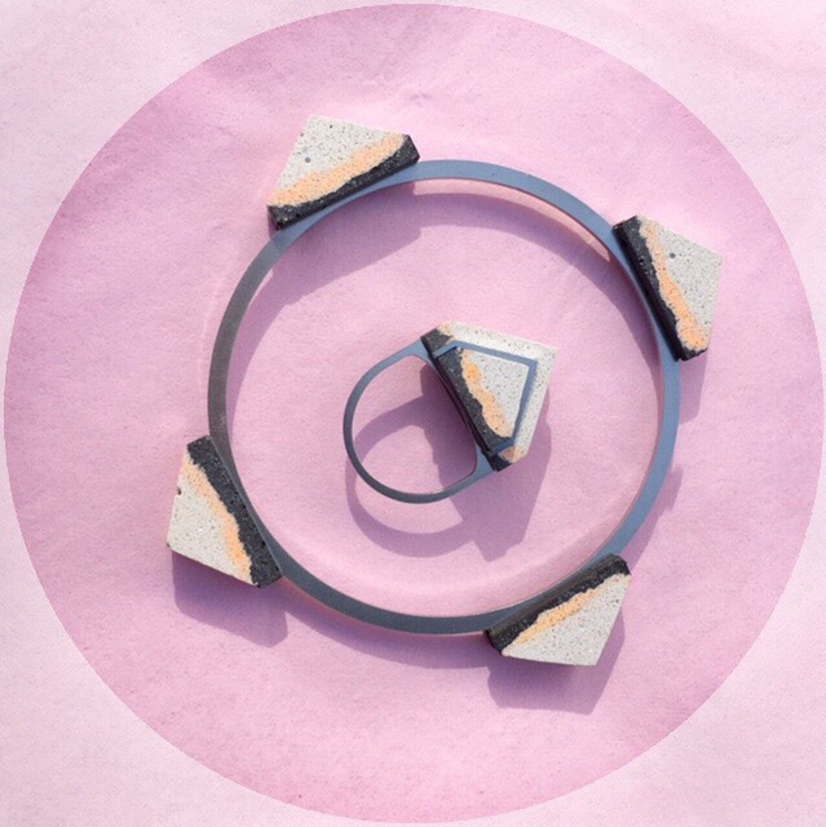 Hand mixed and dyed jesmonite with stainless steel from Hackney based Promises Promises. Bangle £44 and ring £36.