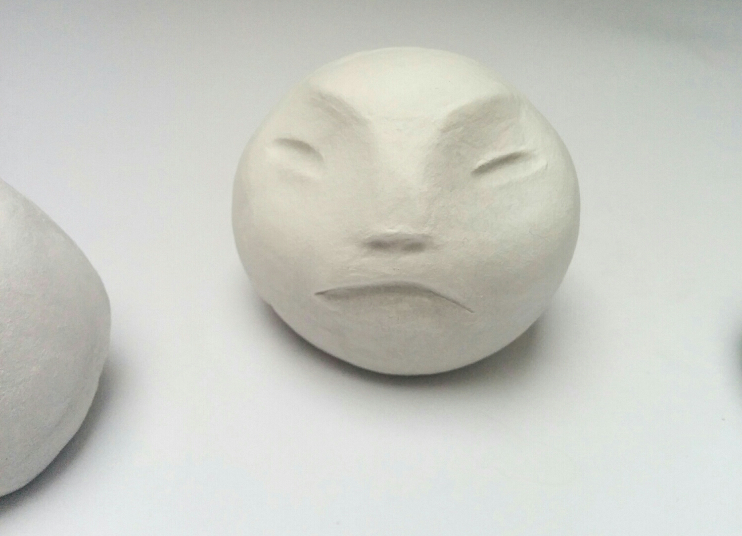 clay heads - romica spiegl-jones of romica jones design