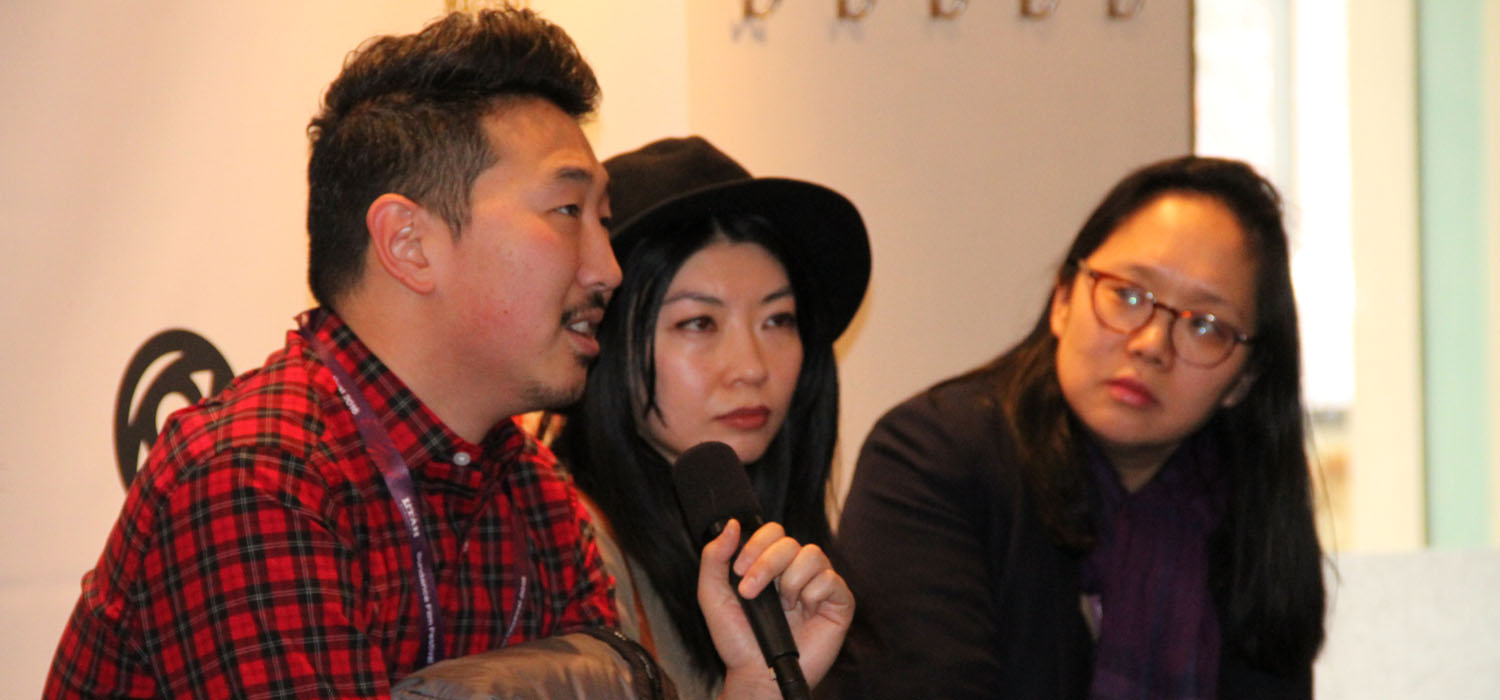 At a panel during the 2016 Sundance Film Festival, Director Andrew Ahn articulates the challenges of bringing minority perspectives and voices to the mainstream as director Mila Zuo and moderator Irene Cho listen in. (Photo: Abraham Ferrer/Visual Communications Photographic Archive)