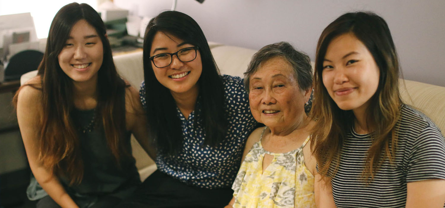 Director Fran Ito with Visual Communications summer interns (from left): Connie Oh, Farrah Su, and Kathy Pham. (Photo: Abraham Ferrer/Visual Communications Photographic Archive)