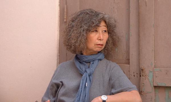 "DIRECTOR DAI SIL KIM-GIBSON IN CUBA, CIRCA 2006 TO SHOOT HER DOCUMENTARY ""MOTHERLAND."" (PHOTO: COURTESY THE FILMMAKER)"