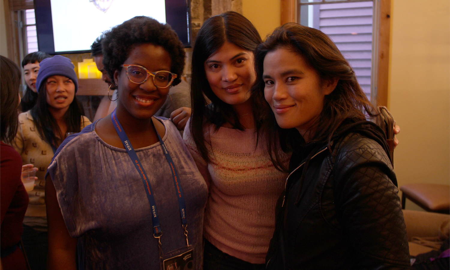 Kickstarter Lodge's Iyabo Boyd is greeted by filmmakers Valerie Castillo Martinez and Diane Paragas. (Photo: Abraham Ferrer/Visual Communications Photographic Archive)