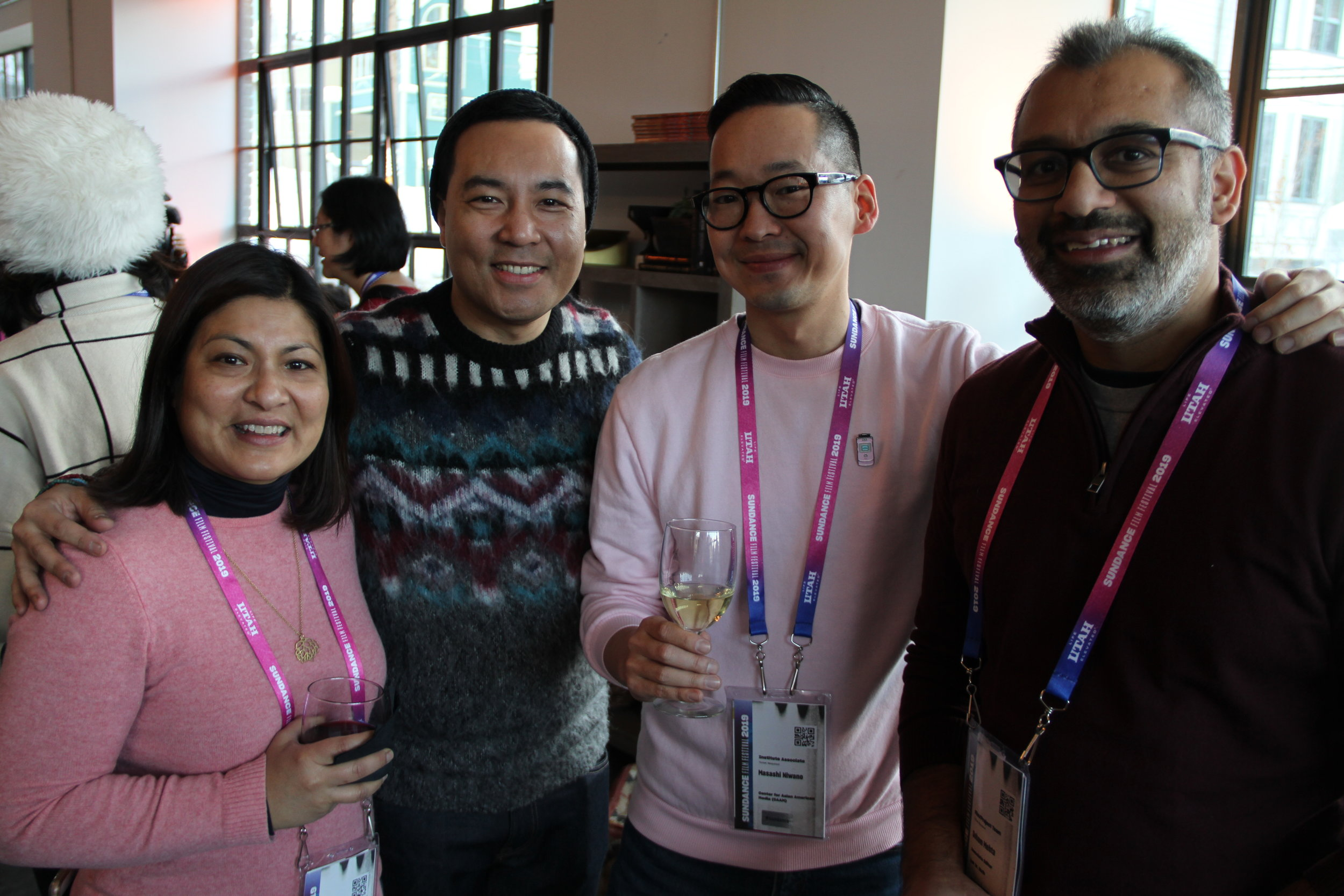 CAAMsters Sapana Sakya and Masashi Niwano greet John D. Lee and filmmaker Soham Mehta at the Asian Pacific Filmmakers Experience in Park City's RYOT & VICE Studios meet-up. (Photo: Abraham Ferrer/Visual Communications Photographic Archive)