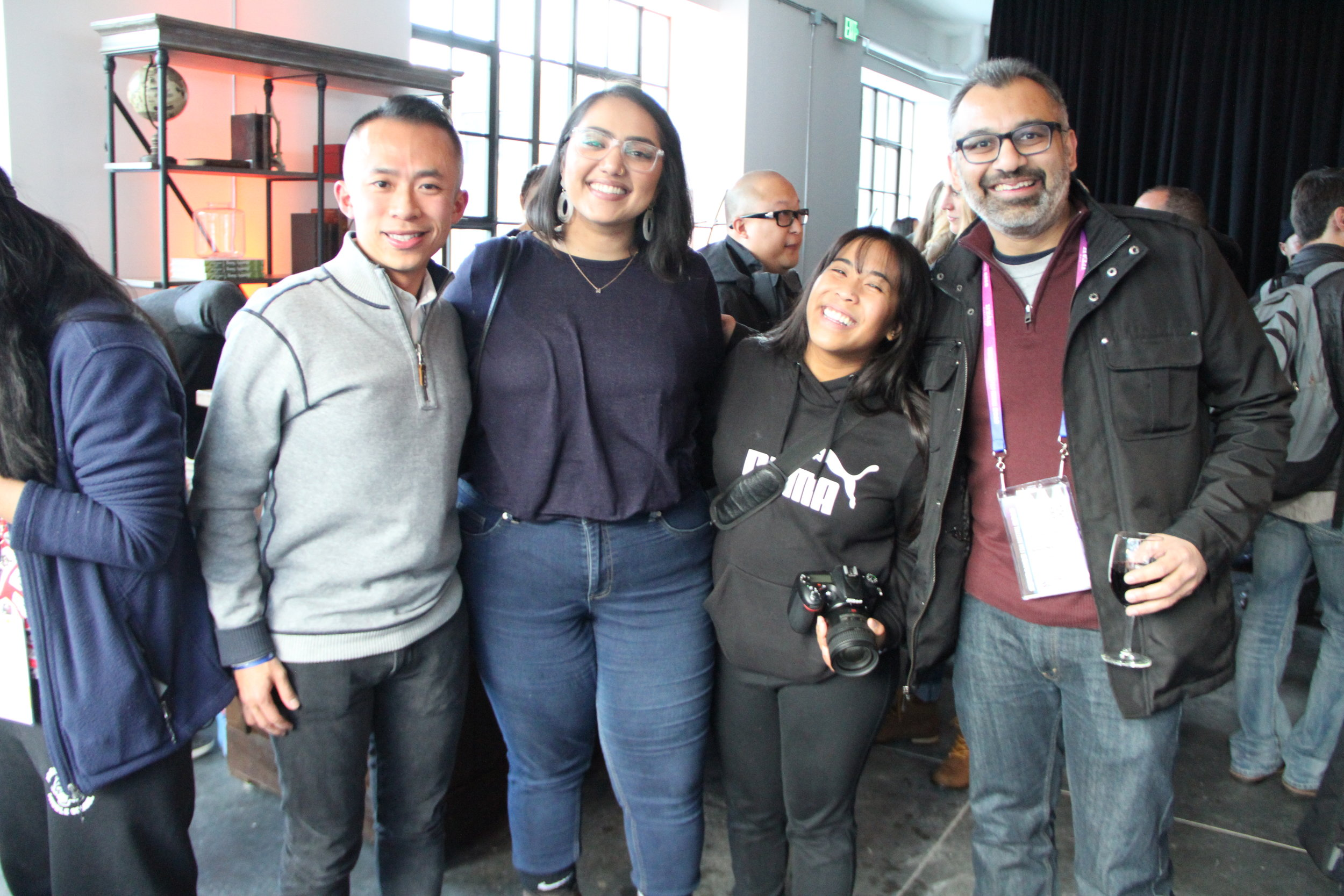 At the RYOT & VICE Studios Lounge, Kollaboration L.A.'s Manpreet Kaur and Aubrey Magalang welcome publicist and San Francisco Film Commissioner Jack Song and filmmaker Soham Mehta. (Photo: Abraham Ferrer/Visual Communications Photographic Archive)