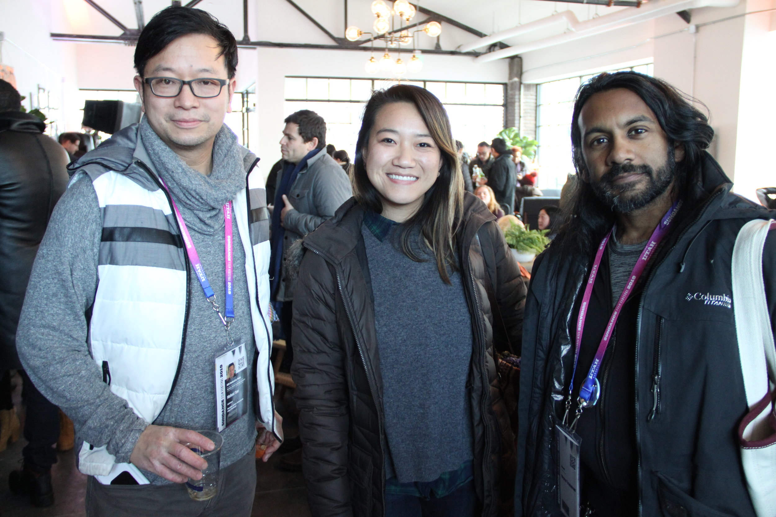 Michael Tow, an adviser for the Boston Asian American Film Festival and friend meet up with Mayuran Tiruchelvam at the Asian Pacific Filmmakers Experience in Park City meet-up at RYOT & VICE Studios Lounge. (Photo: Abraham Ferrer/Visual Communications Photographic Archive)