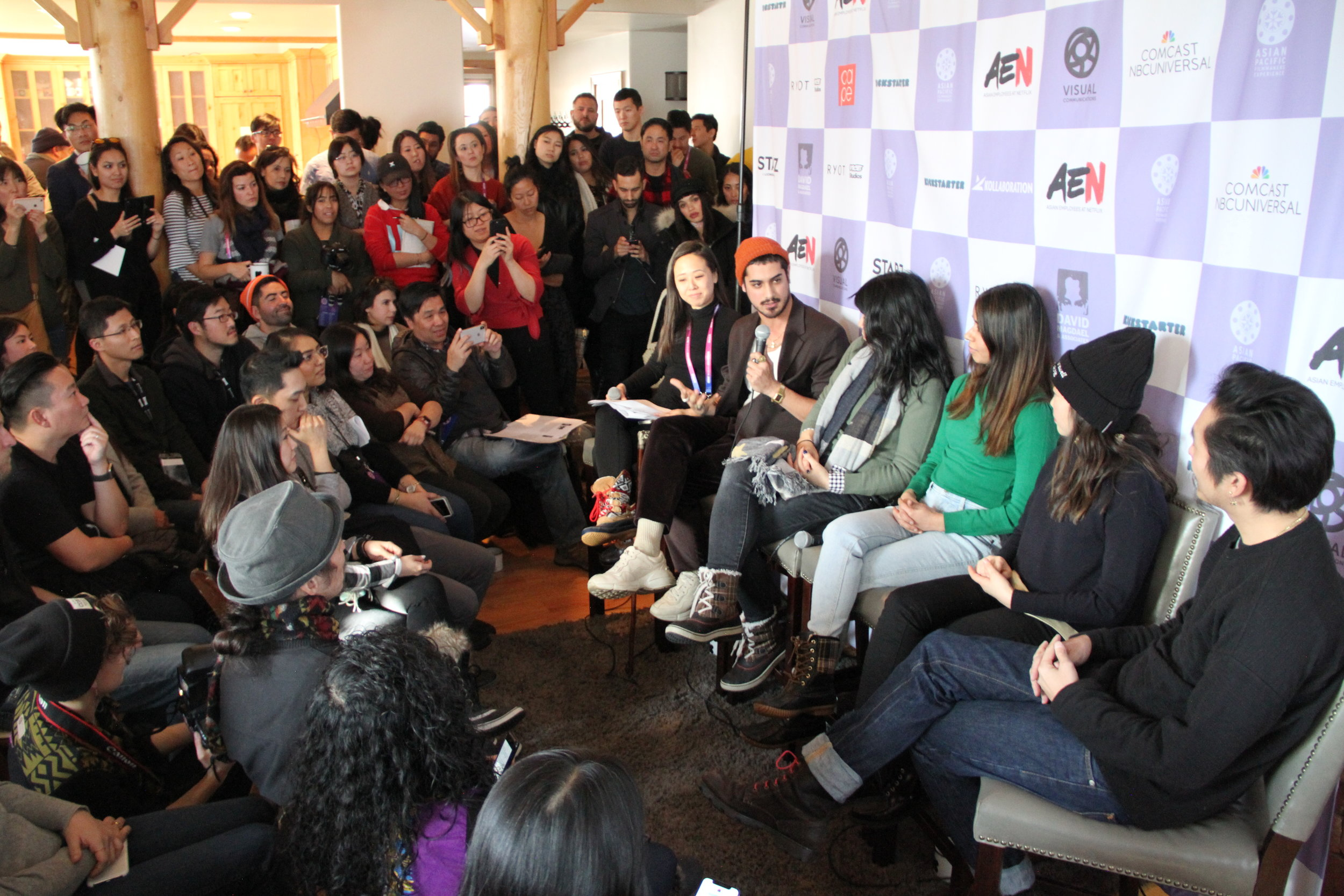 With a packed Kickstarter Lodge looking on, #APAParkCity Committee member Minji Chang gets things started by challenging the panelists to offer their forecasts for what 2019 holds for Asian Pacific filmmakers and creative artists. (Photo: Abraham Ferrer/Visual Communications Photographic Archive)