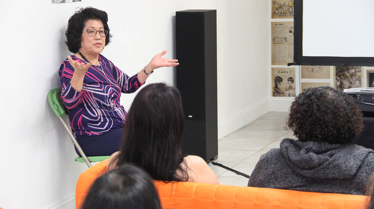 Veteran VC filmmaker Janice D. Tanaka chats with a capacity audience following the screening of her documentary WHEN YOU'RE SMILING: THE DEADLY LEGACY OF INTERNMENT. (Photo: Abraham Ferrer/Visual Communications Photographic Archive)