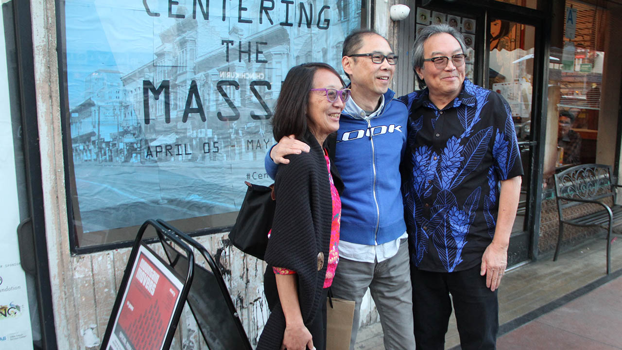 Donna Kotake, Keith Lee, and Eddie Wong celebrate a BUSY weekend at CENTERING THE MASSES as Visual Communications' massive Founders' exhibit, AT FIRST LIGHT: THE DAWNING OF ASIAN PACIFIC AMERICA also opened at the Japanese American National Museum. (Photo: Abraham Ferrer/Visual Communications Photographic Archive)