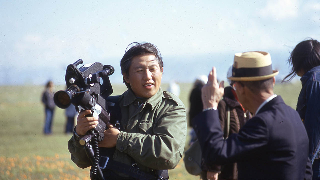 Visual Communications co-founder Robert A. Nakamura on location during the Asian American Wildflower Tour, circa 1972. The National Film Preservation Foundation has awarded VC a prestigious federal matching grant to preserve and restore Nakamura's WATARIDORI: BIRDS OF PASSAGE and HITO HATA: RAISE THE BANNER (co-directed with Duane Kubo). Photo: Visual Communications Photographic Archive