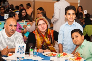 Families join students and mentors in celebrating at the Academic Achievement Banquet.