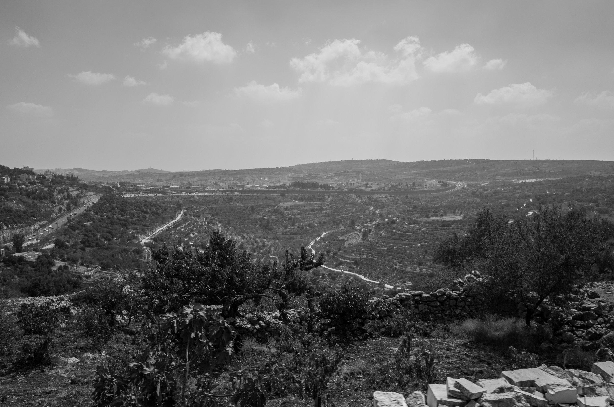 Peering over the border wall, Bethlehem, 2017