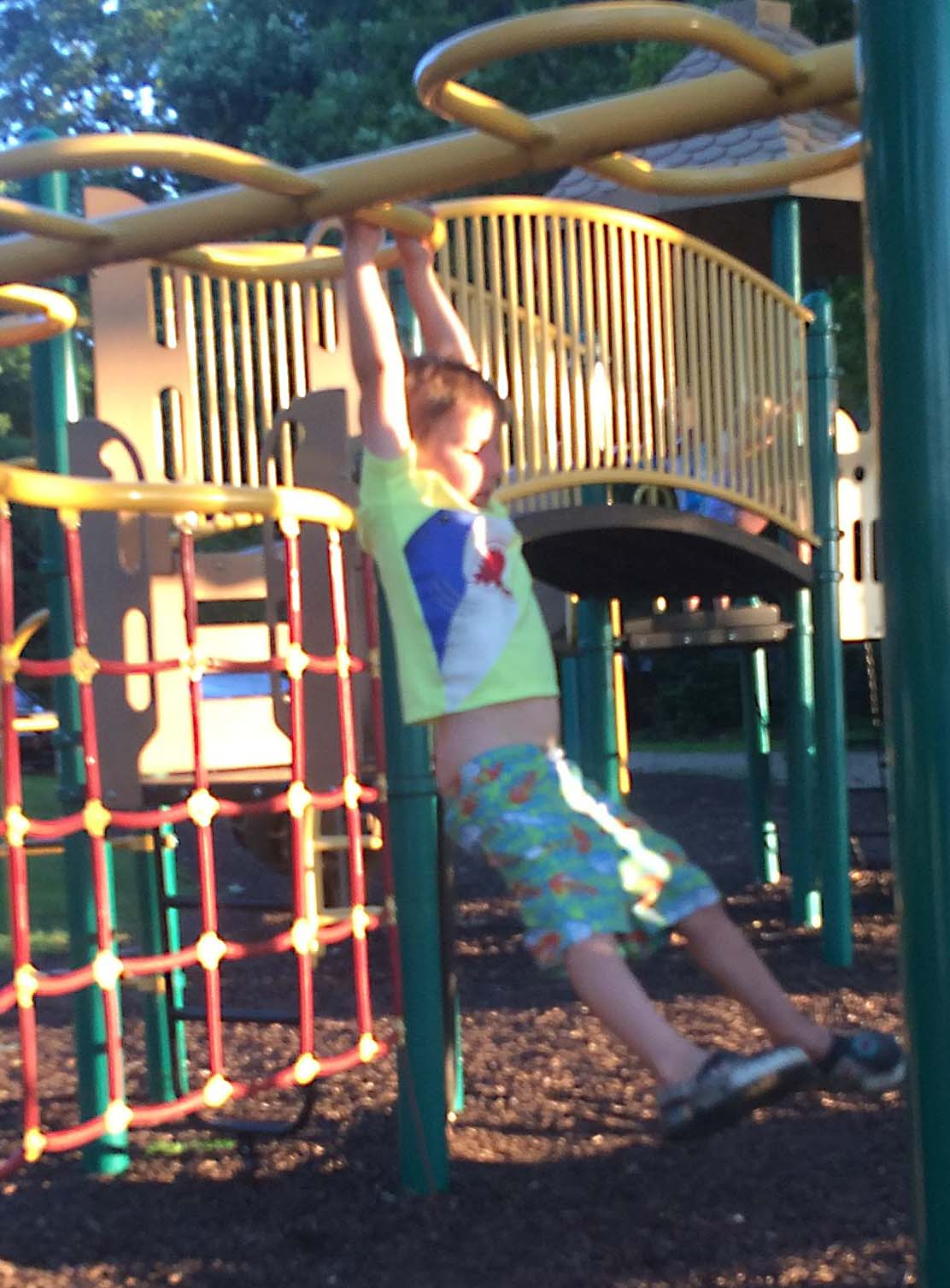 Ollie getting the hang of monkey bars - just hope his pants stay put!