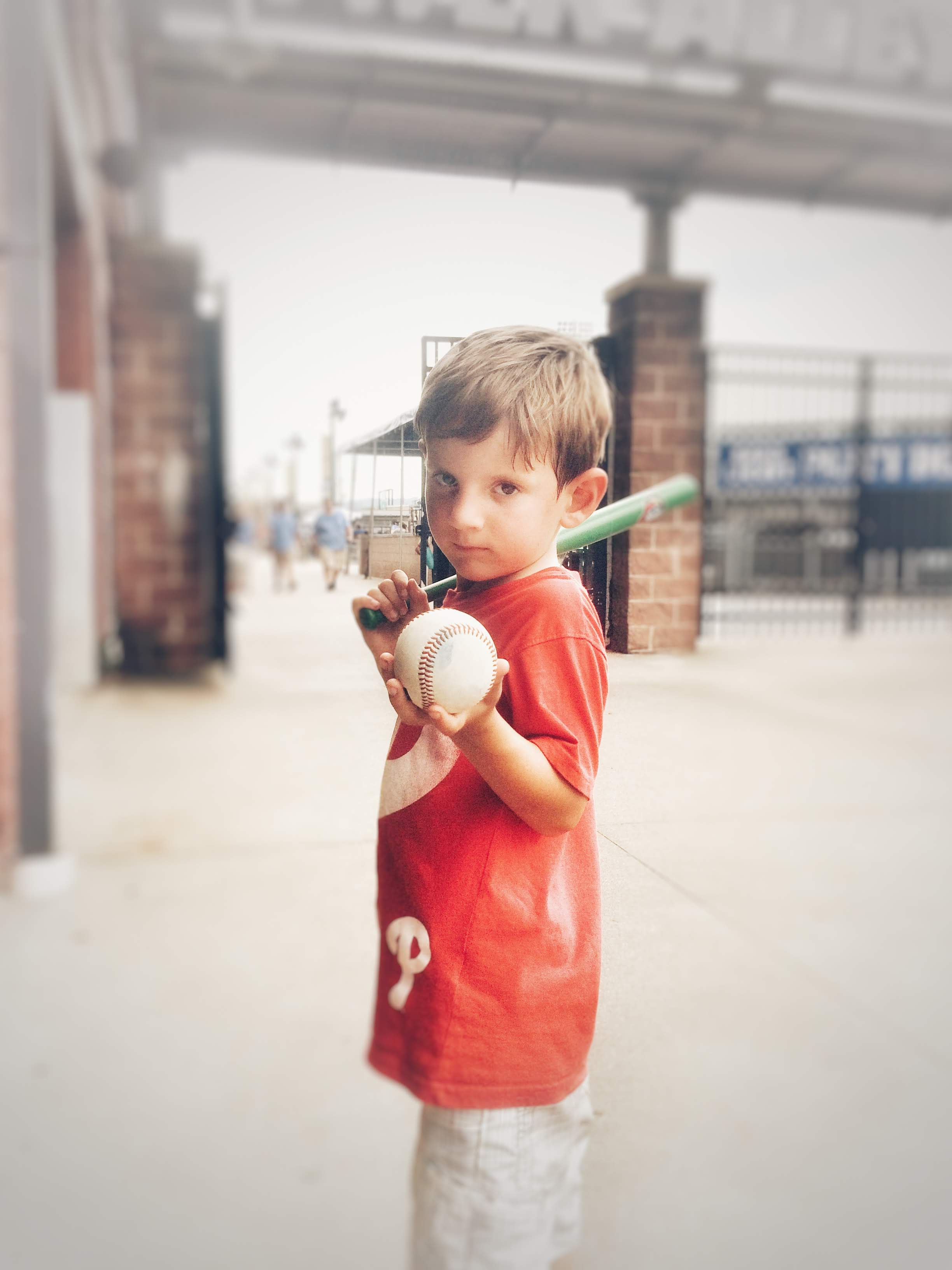 Ollie got a foul ball and a mini bat which was for dad (since we each got one that they gave away while at the Louisville Slugger tour)