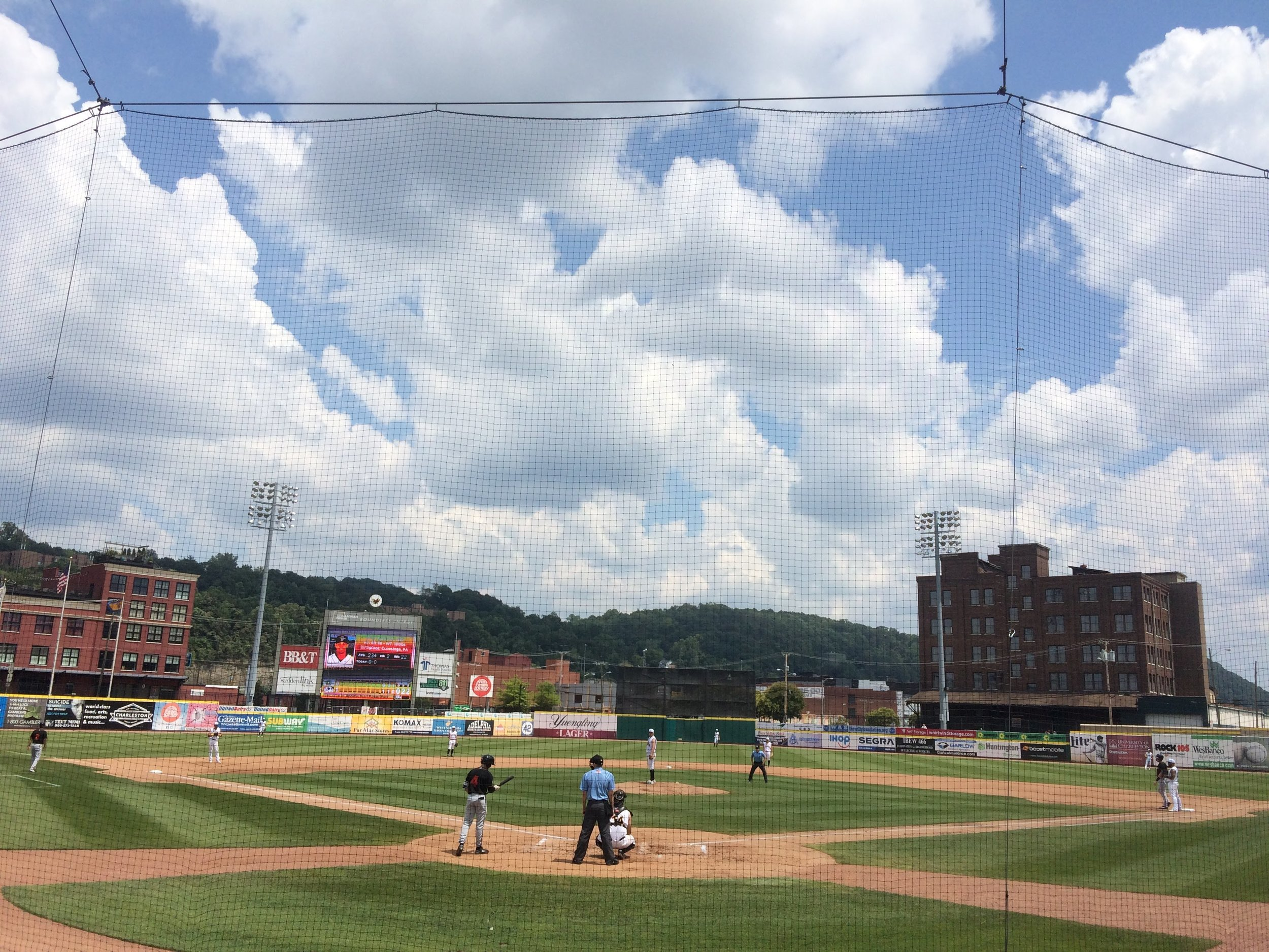 So cool! A minor league ball game between the West Virginia Power and Delmarva Shorebirds. Foul balls dropping everywhere.