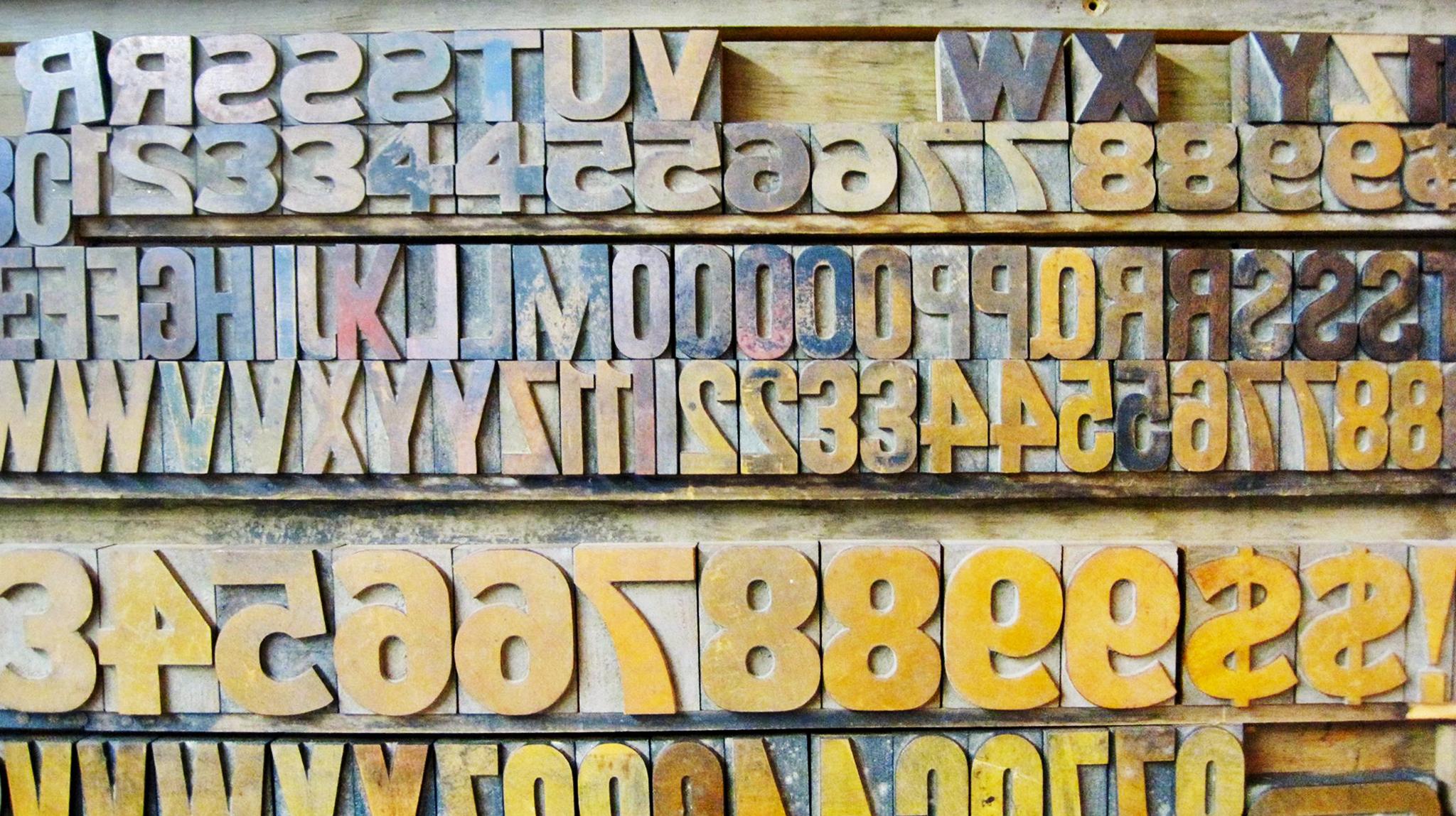 Set of hand carved letter press letters.