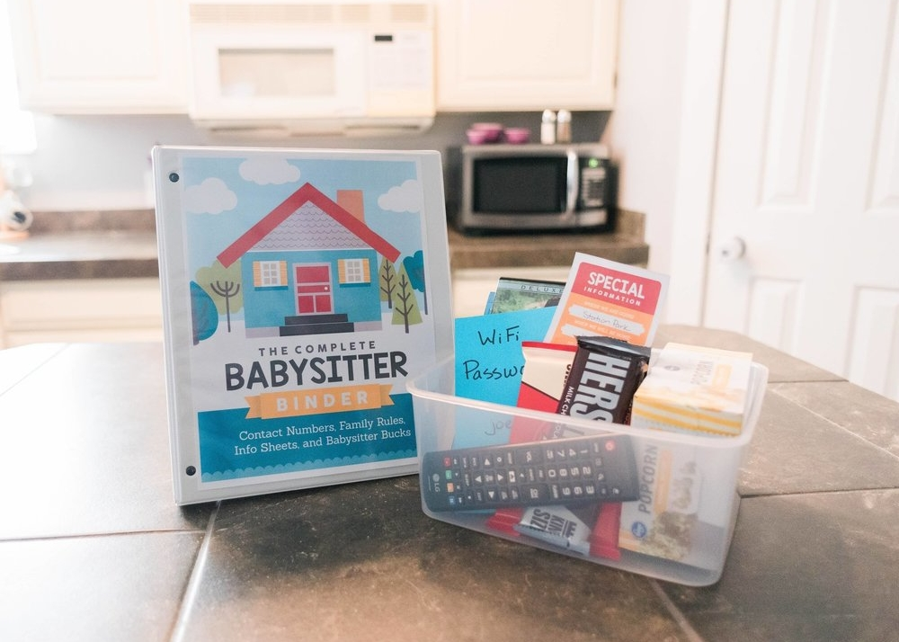 Babysitter binder with emergency contact information and more. Babysitting box with treats, movies and things for the sitter.