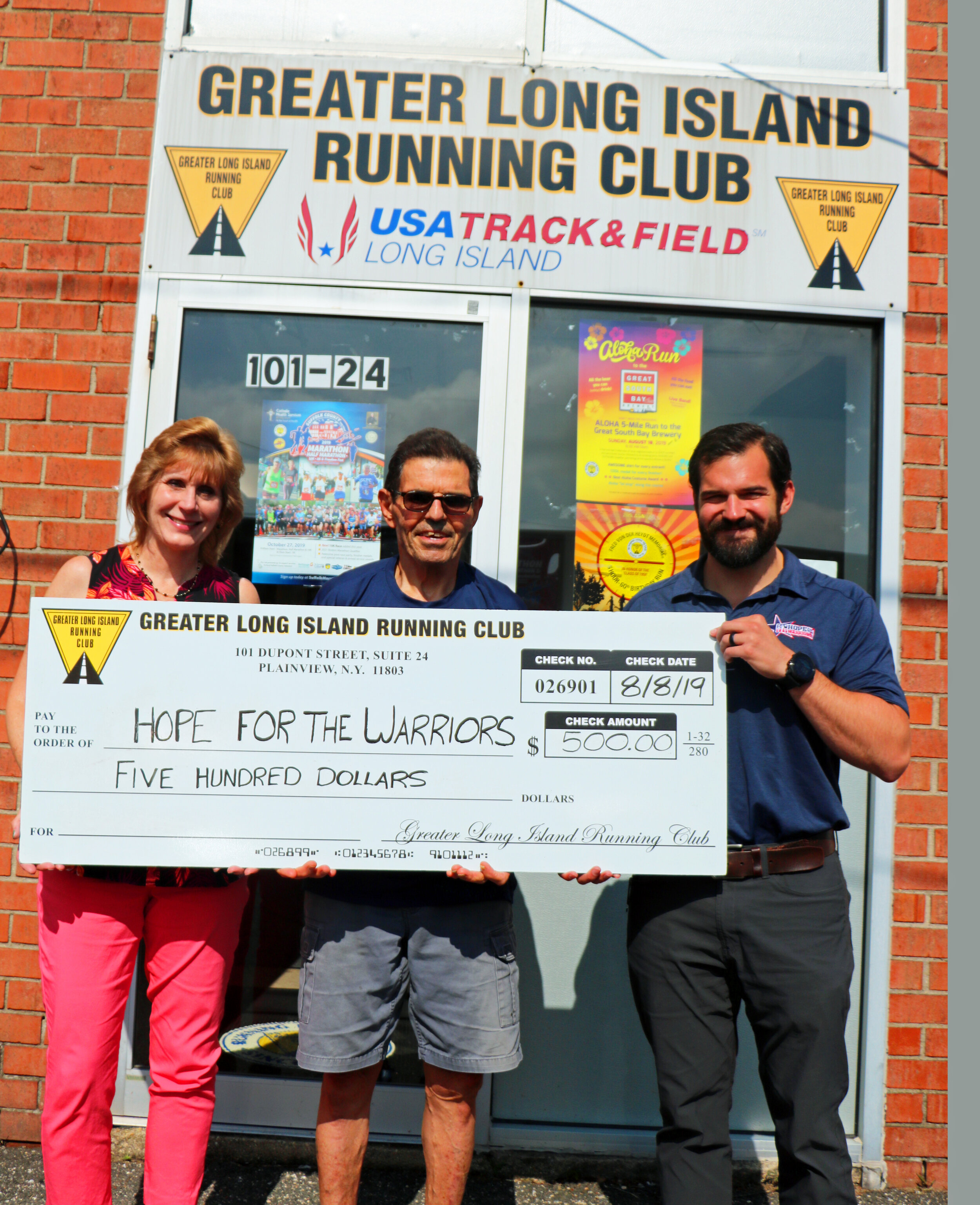 Pictured here, Steve Bartomioli of Hope for the Warriors (C) accepts the GLIRC check from GLIRC Executive Director Sue Fitzpatrick (L) and Greenbelt Trail Race Director Nick Palazzo