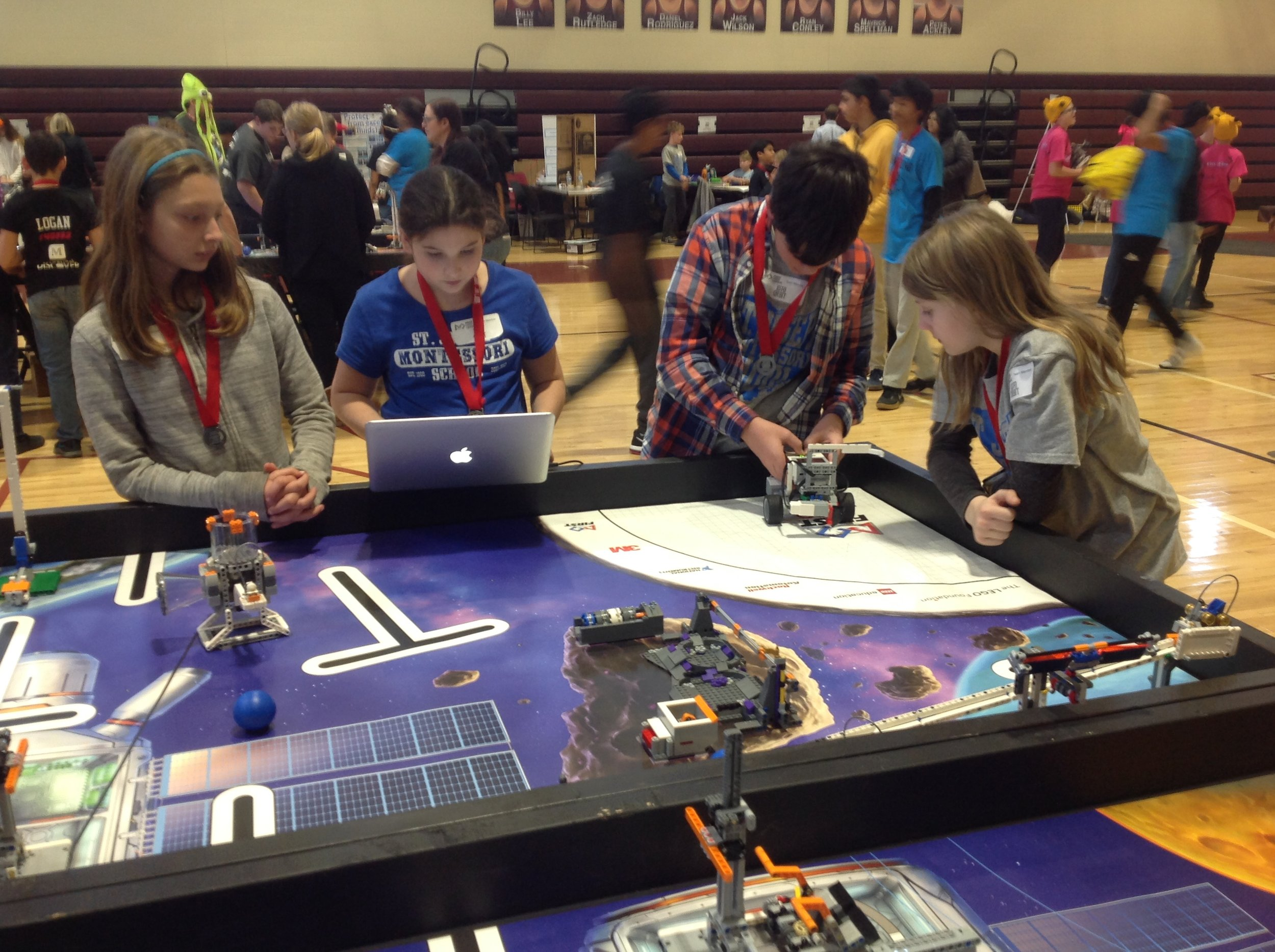 """FIRST LEGO League - This fall, our students took part in FIRST LEGO League, an international competition that has students research and explore a scientific and real-world challenge. This year's theme, """"Into Orbit,"""" had students investigate the challenges humans face in exploring space. For the project's robotics challenge, students designed and programmed a robot to complete missions related to the year's theme."""