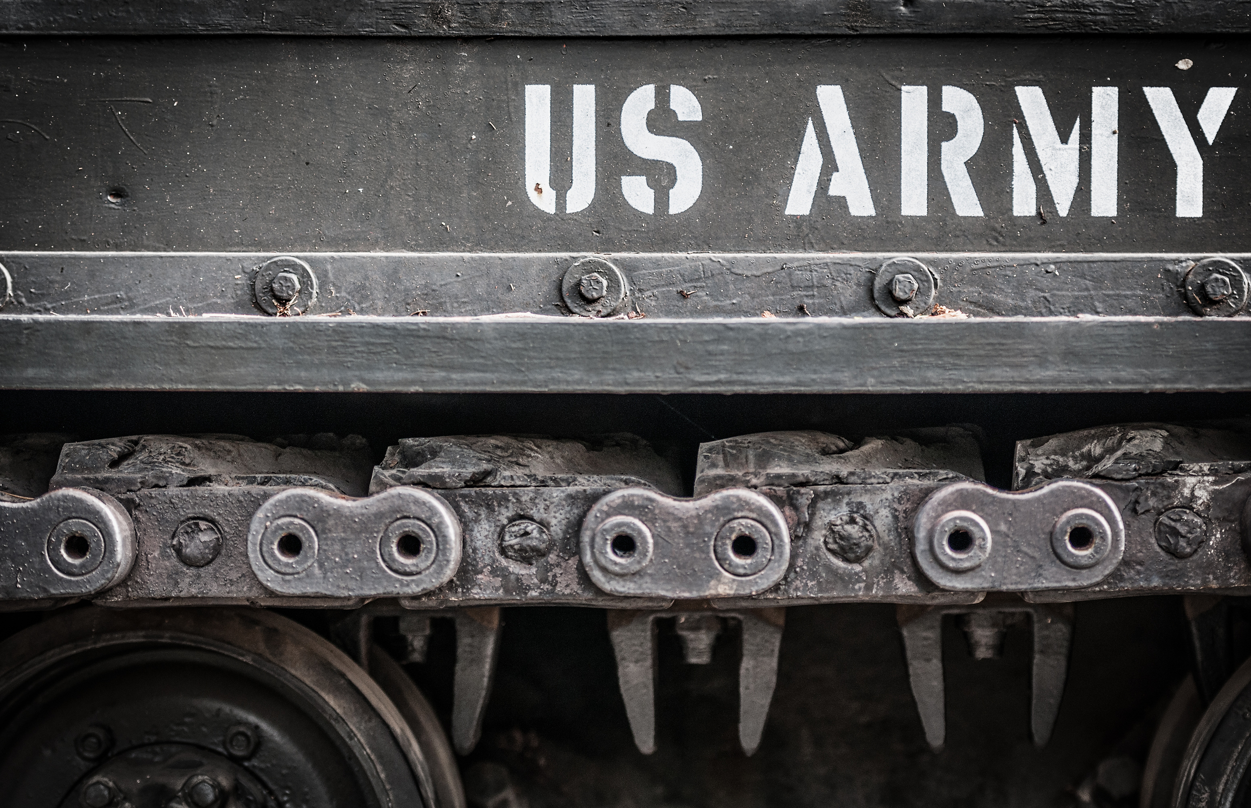 stock-photo-tank-close-up-with-wheel-caterpillar-and-text-us-army-on-it-focus-on-side-of-military-transport-139634210.jpg