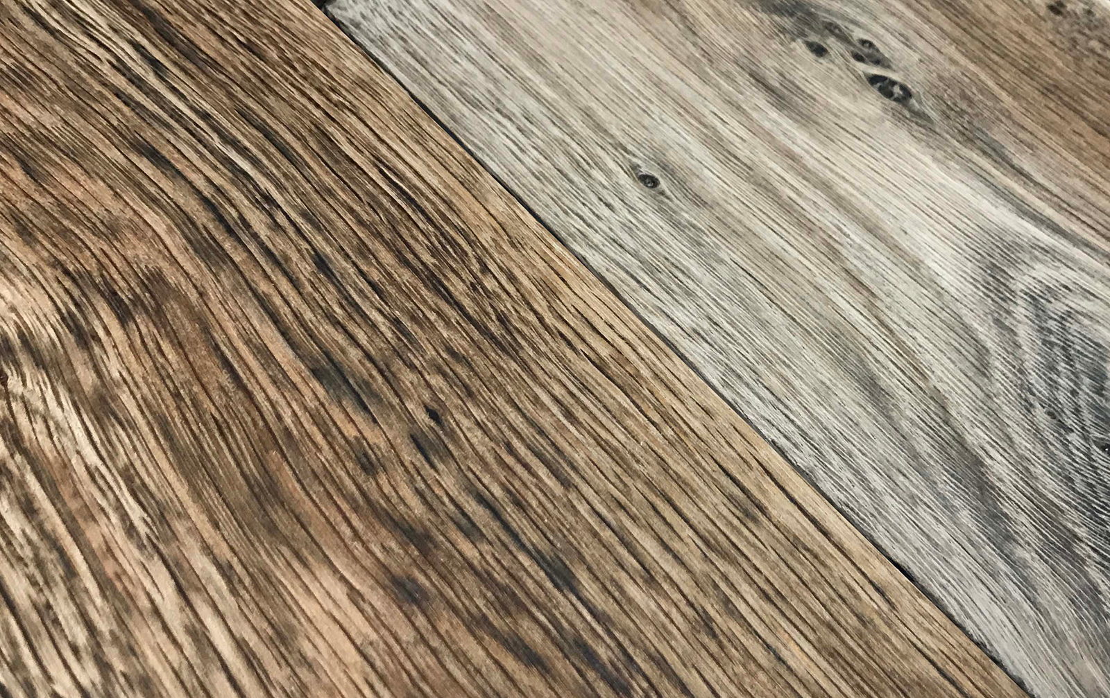 The antiquing effect (graying) of a reactive stain, midway through drying. Within a few hours, all of the boards will have this aged gray color.
