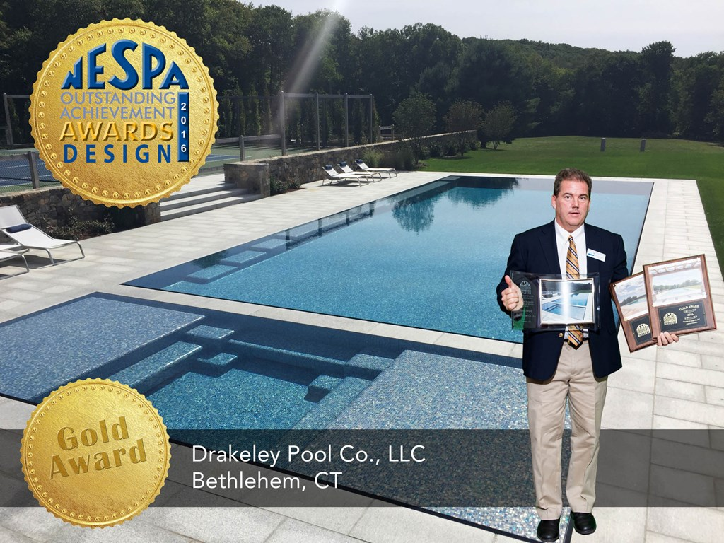 """Bill Drakeley accepts THREE Gold Awards for this glass tiled, knife-edge beauty, fondly referred to as the """"jewel of the property"""" by our client."""