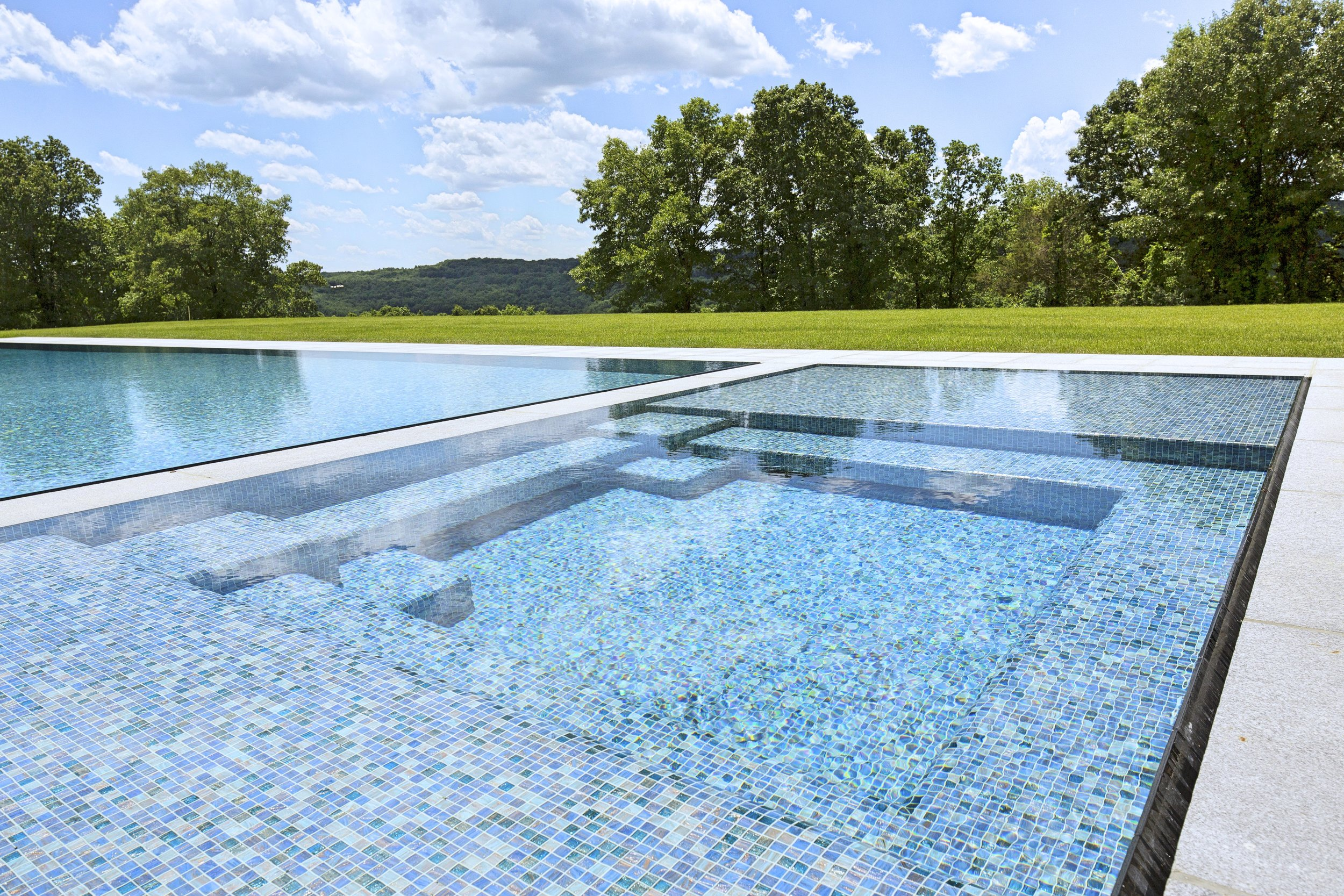 It's not hard to see why this swimming pool/spa combo is called the 'jewel of the property.'