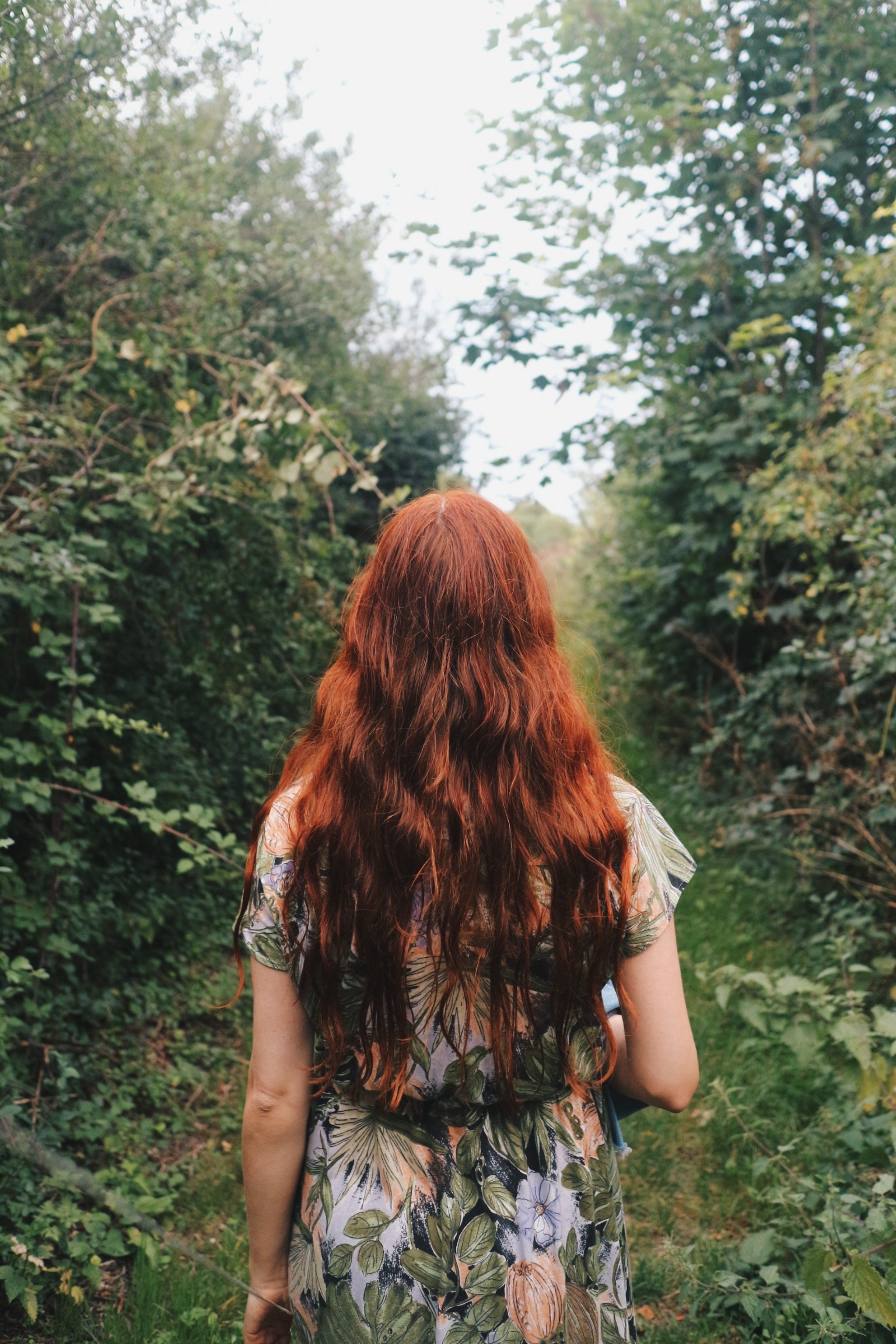 Girl with red hair in the woods