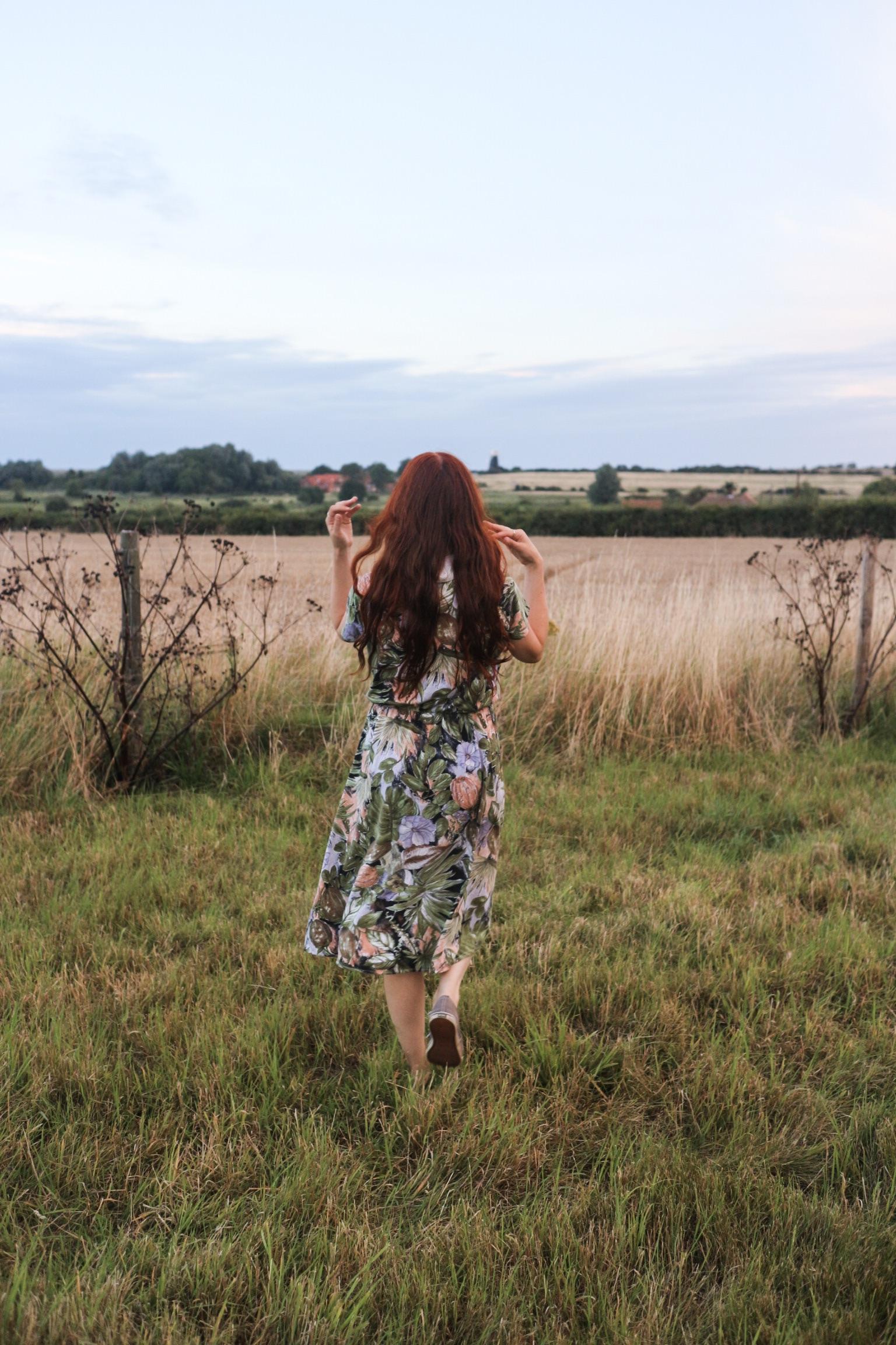 Girl running in meadow
