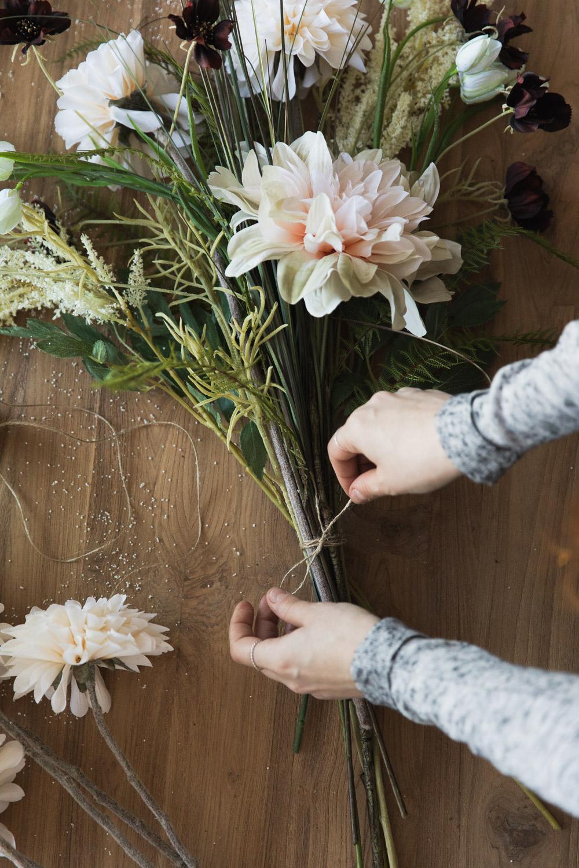 Flower arranging making a bouquet