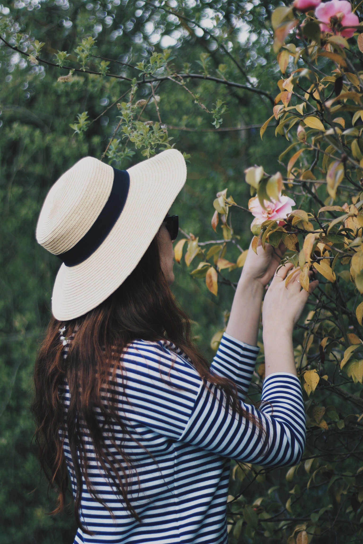 Girl in garden with flowers