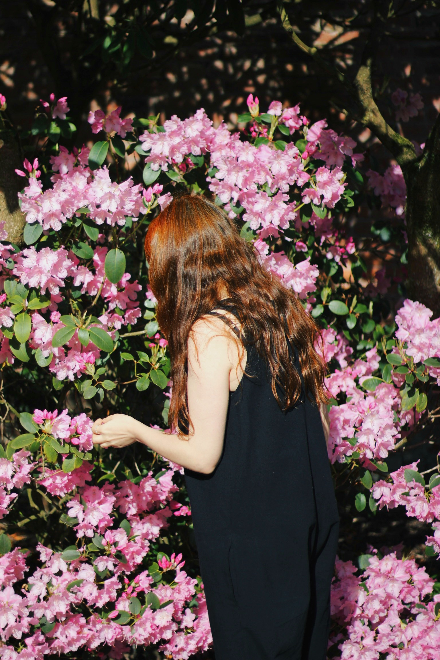 girl wearing jumpsuit with flowers