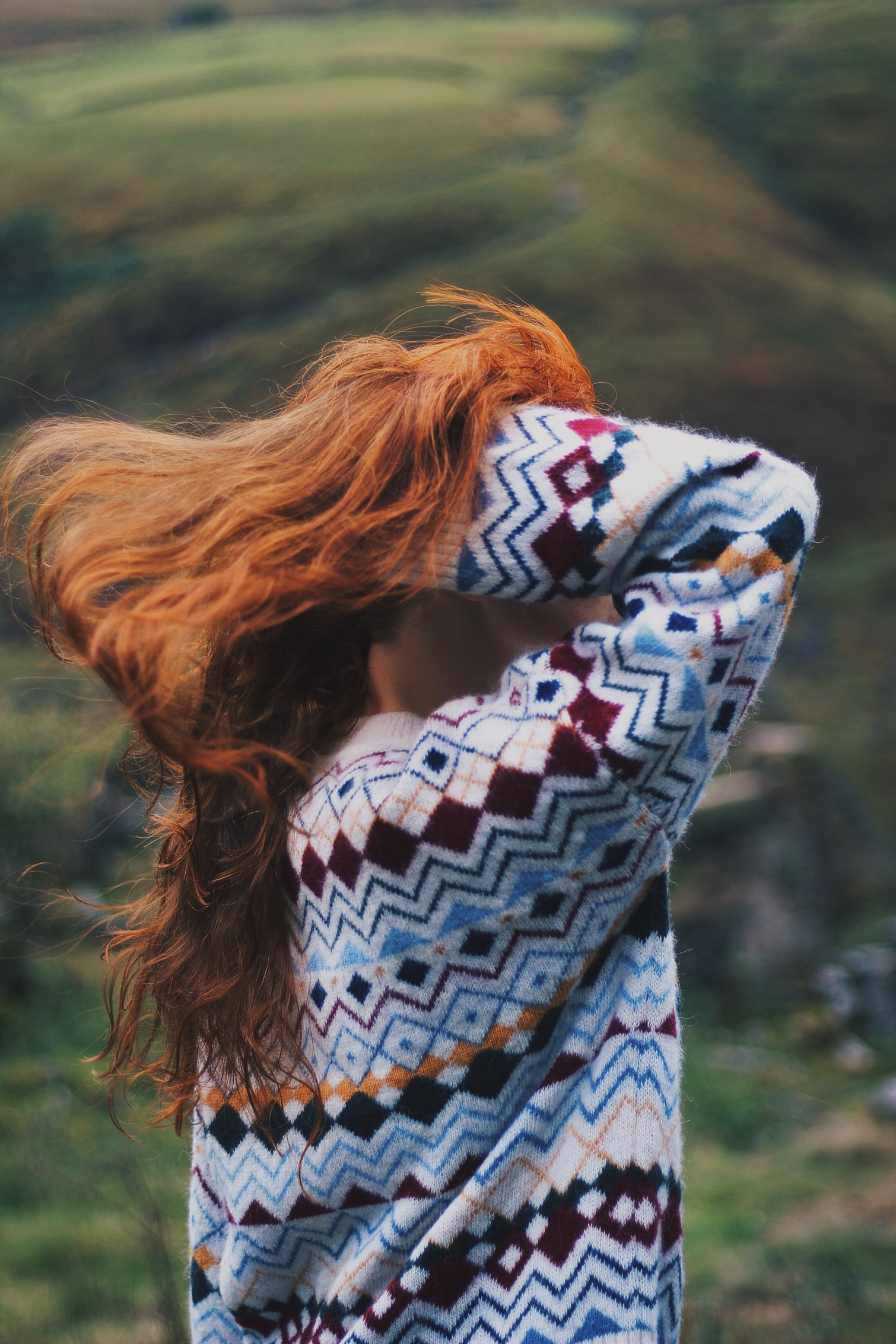 Girl, red hair blowing in wind