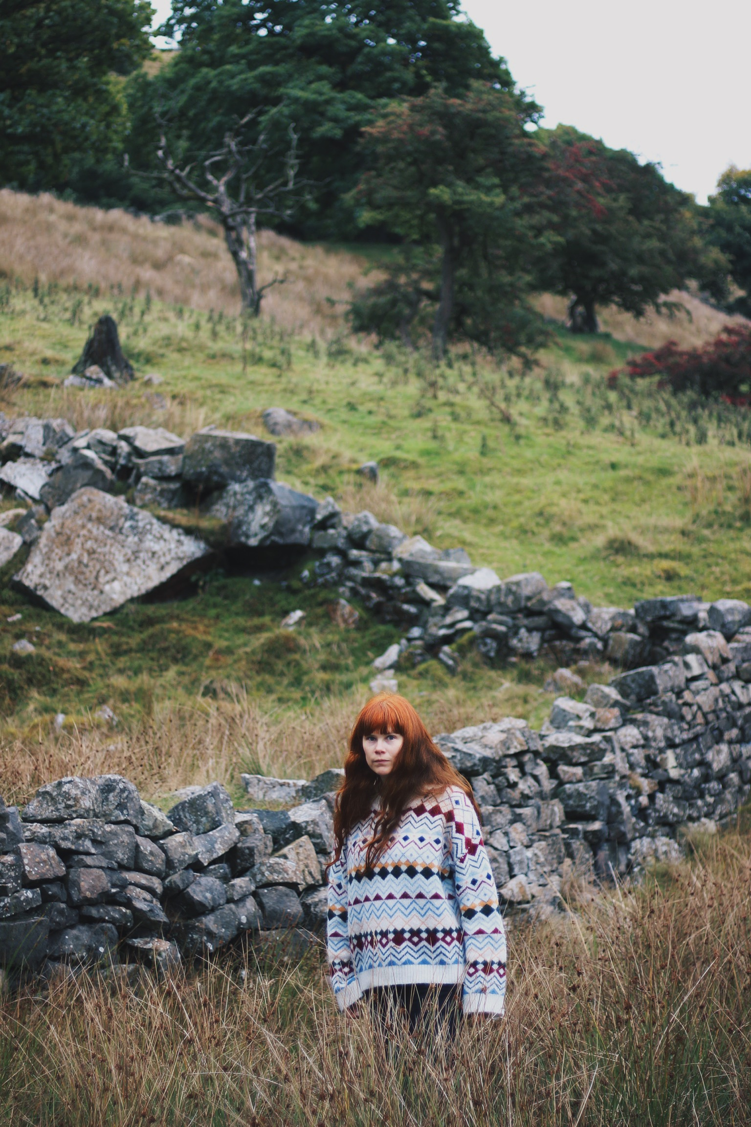 Red haired girl in countryside