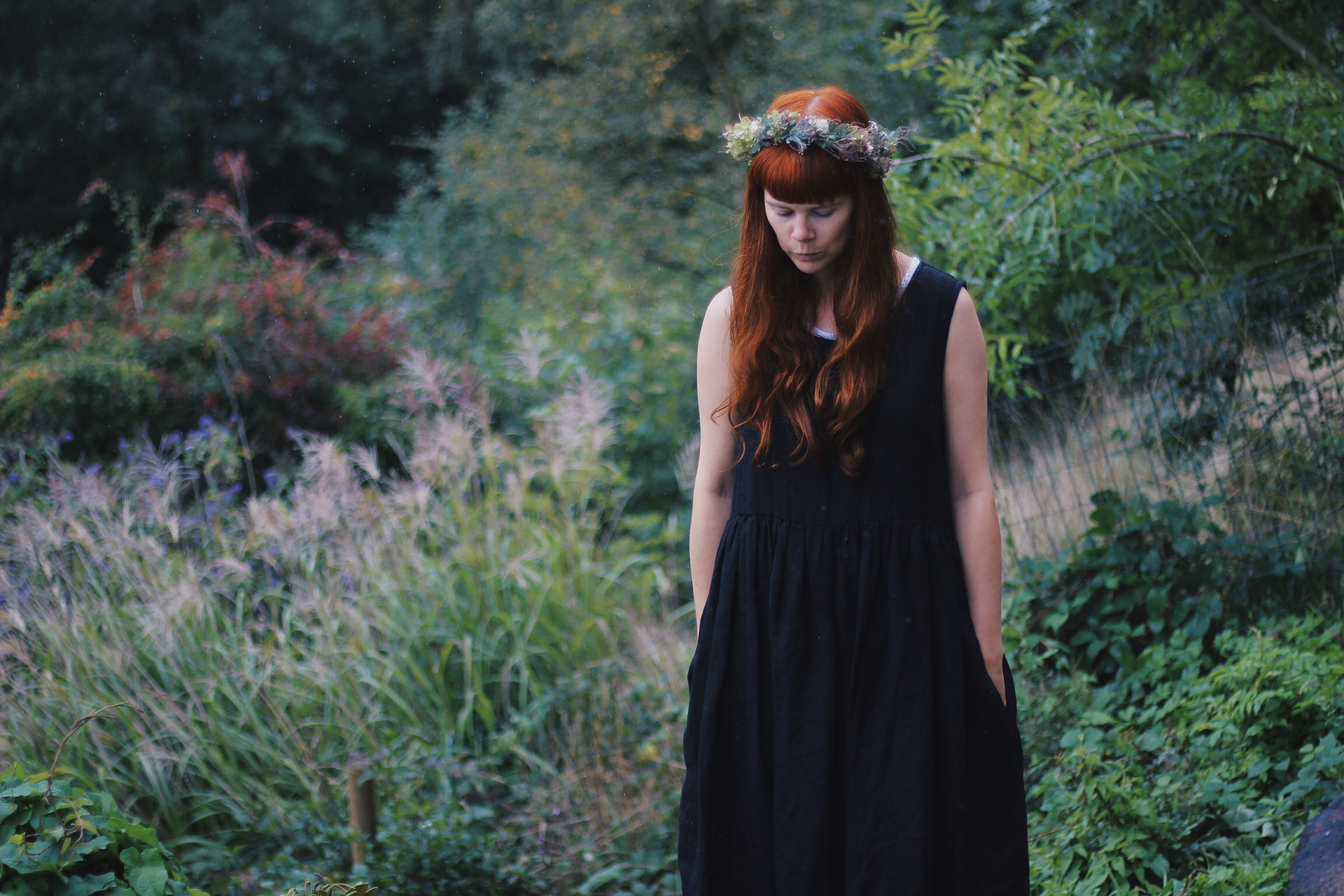 Girl wearing flower crown and black dress