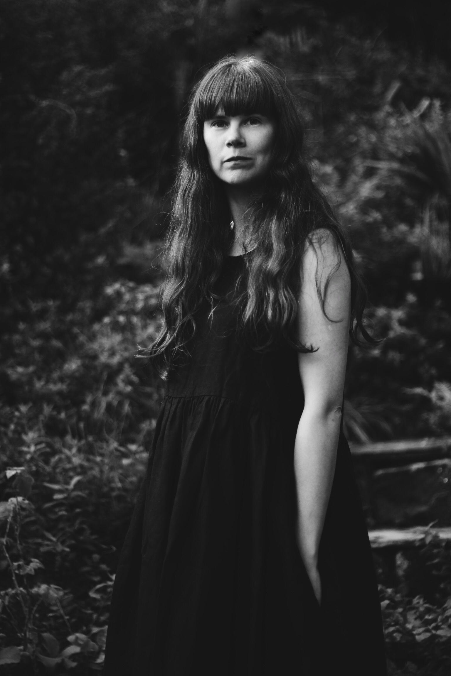 Girl in black linen dress