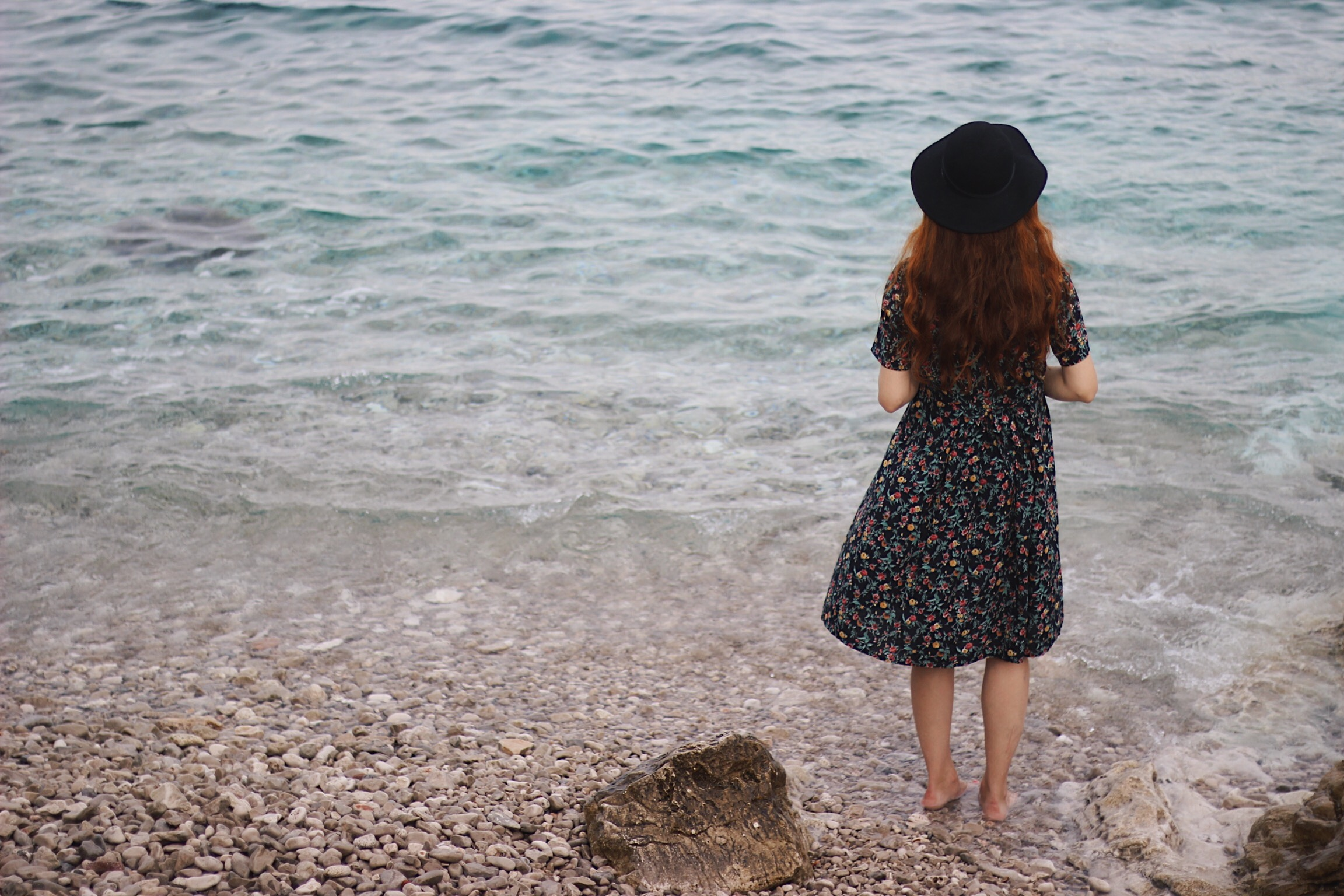 Girl with hat on beach