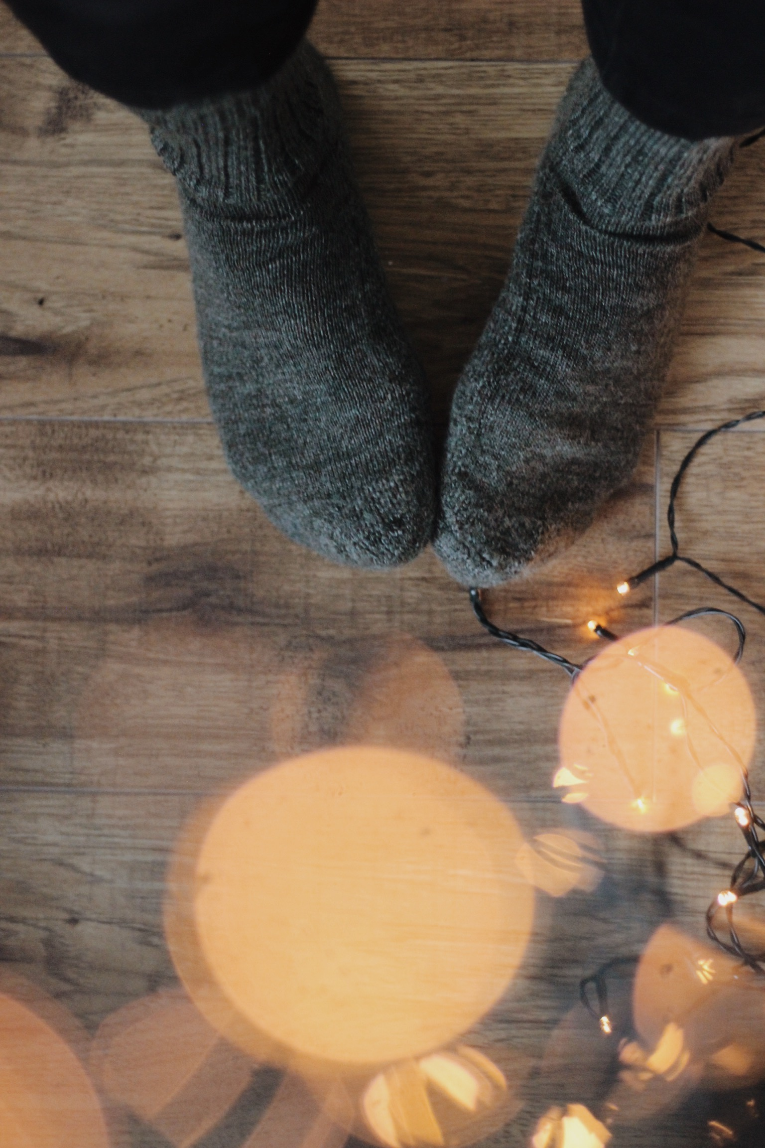Woolly socks and out of focus Christmas tree lights