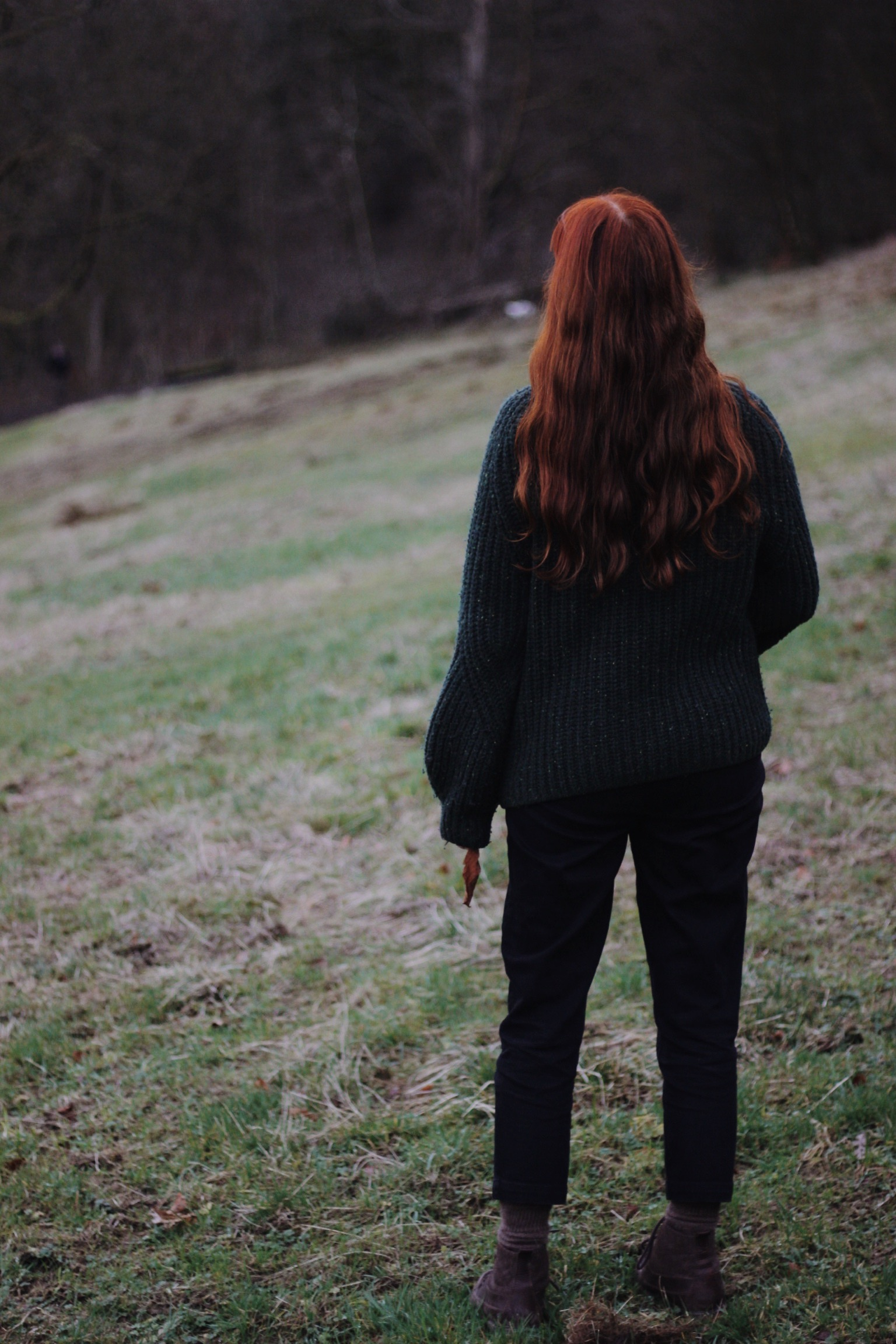 Girl stood in field