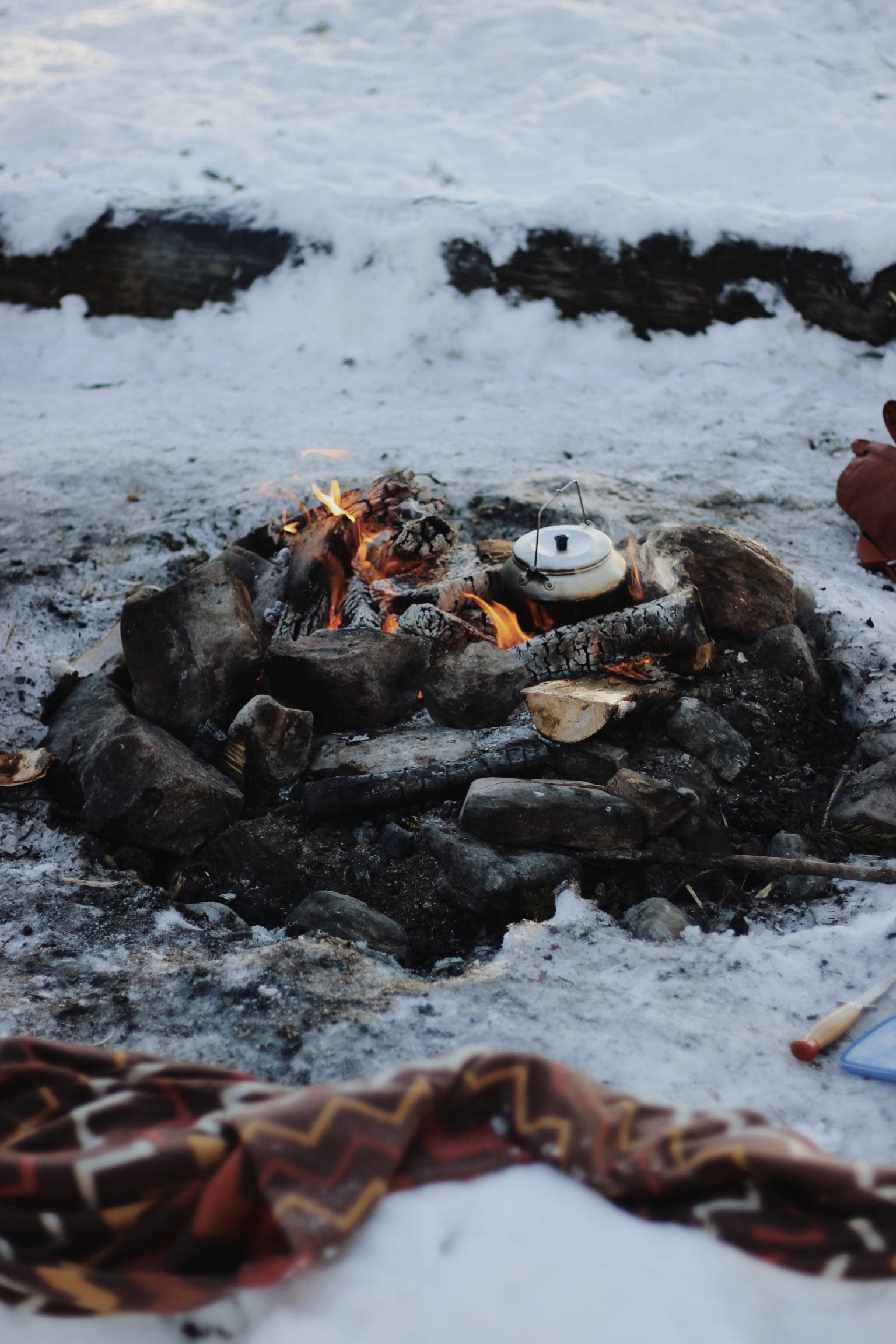 Cooking on a fire outside in the snow, Finnish Lapland