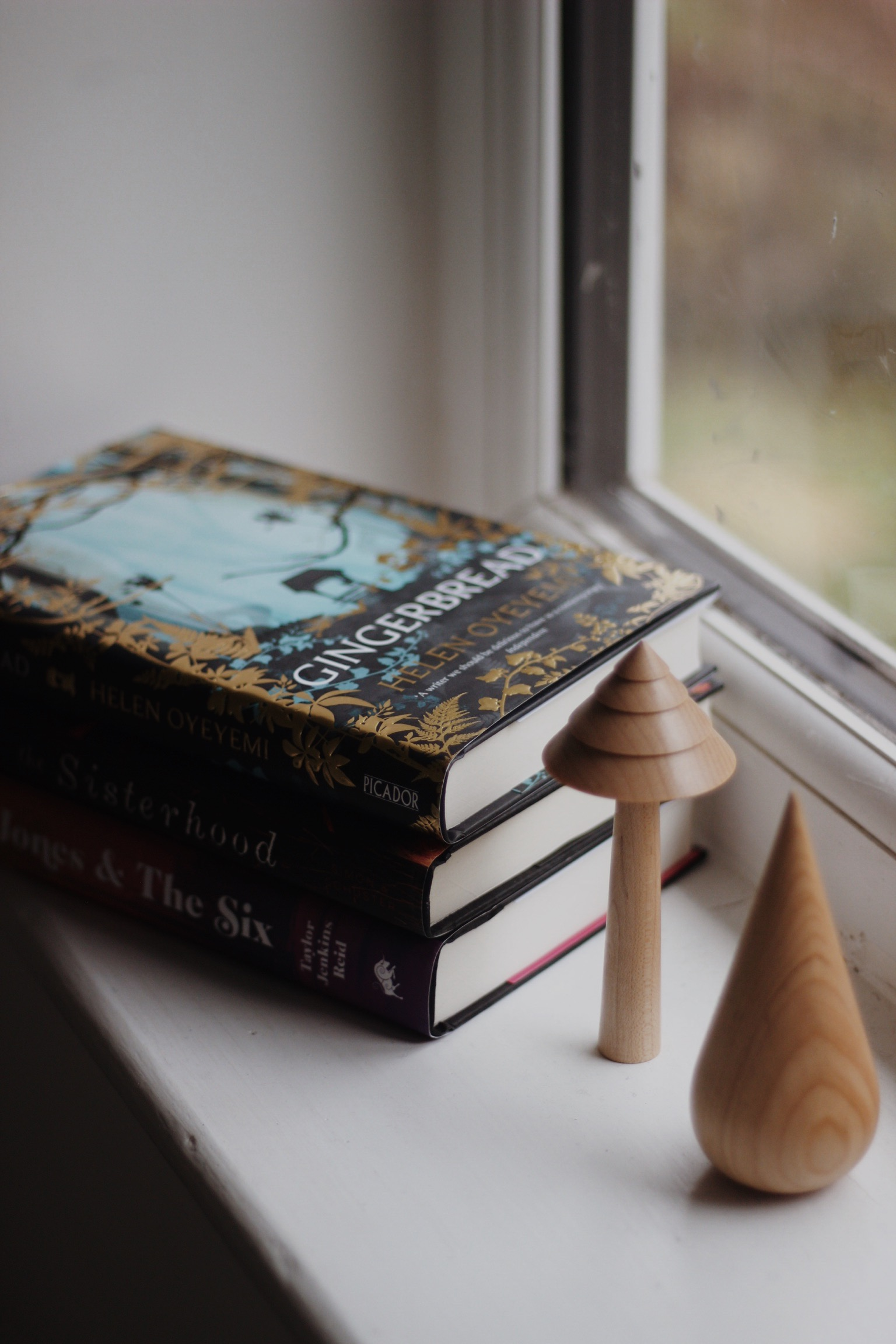 Pile of books on window sill
