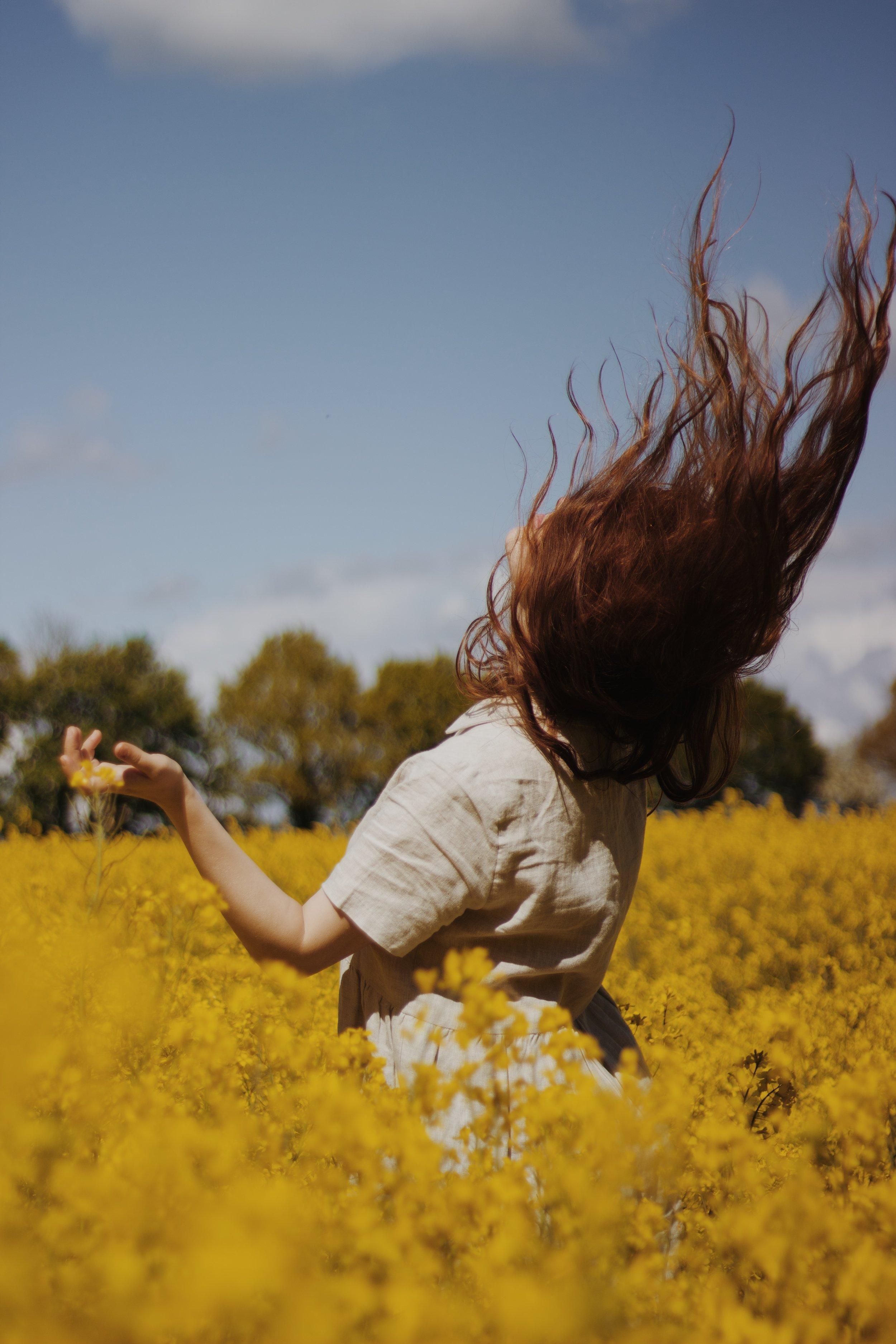 Girl in yellow rapeseed field in Spring | Field + Nest