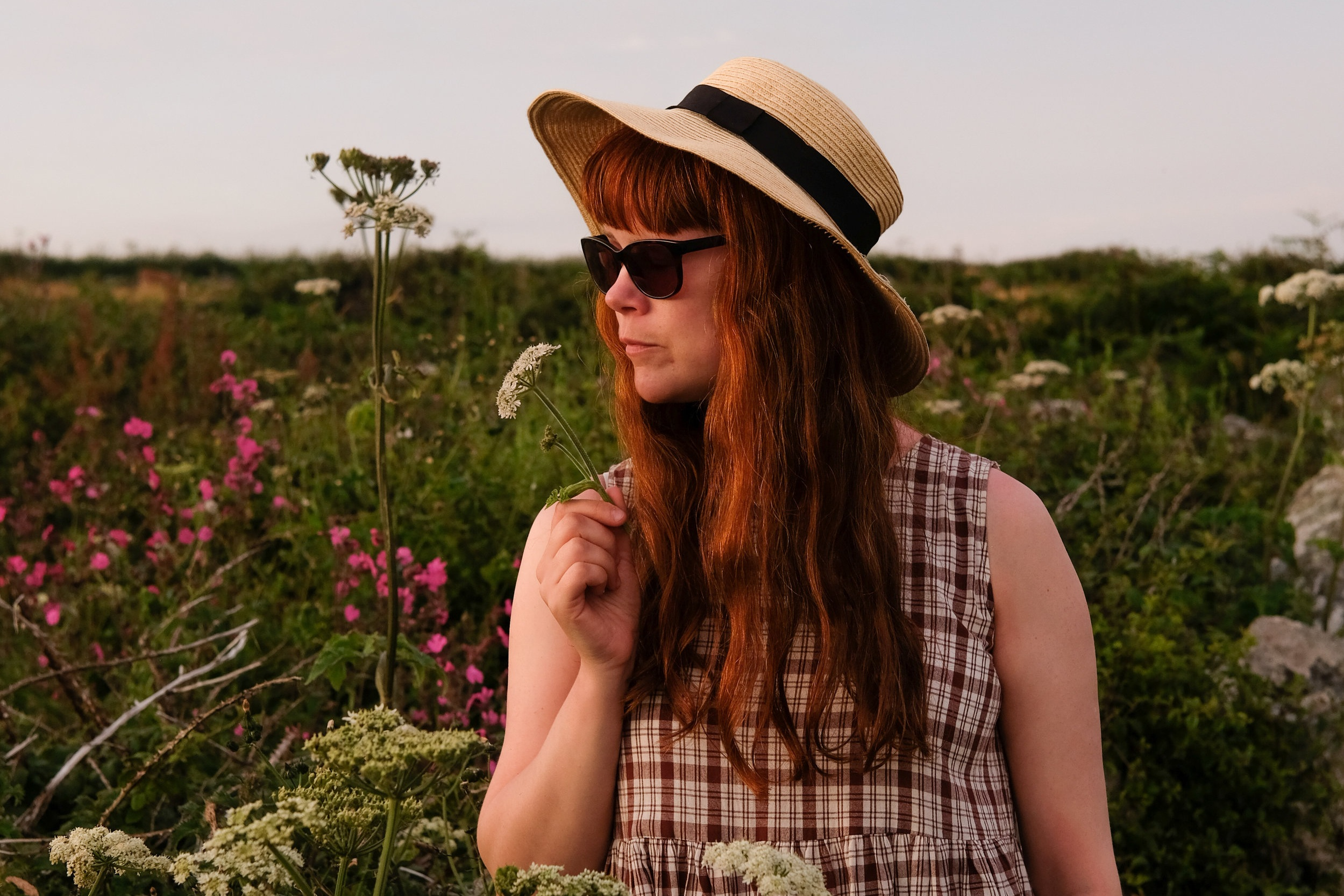 How to Curate a Considered Wardrobe | Girl in meadow wearing gingham dress | Field + Nest