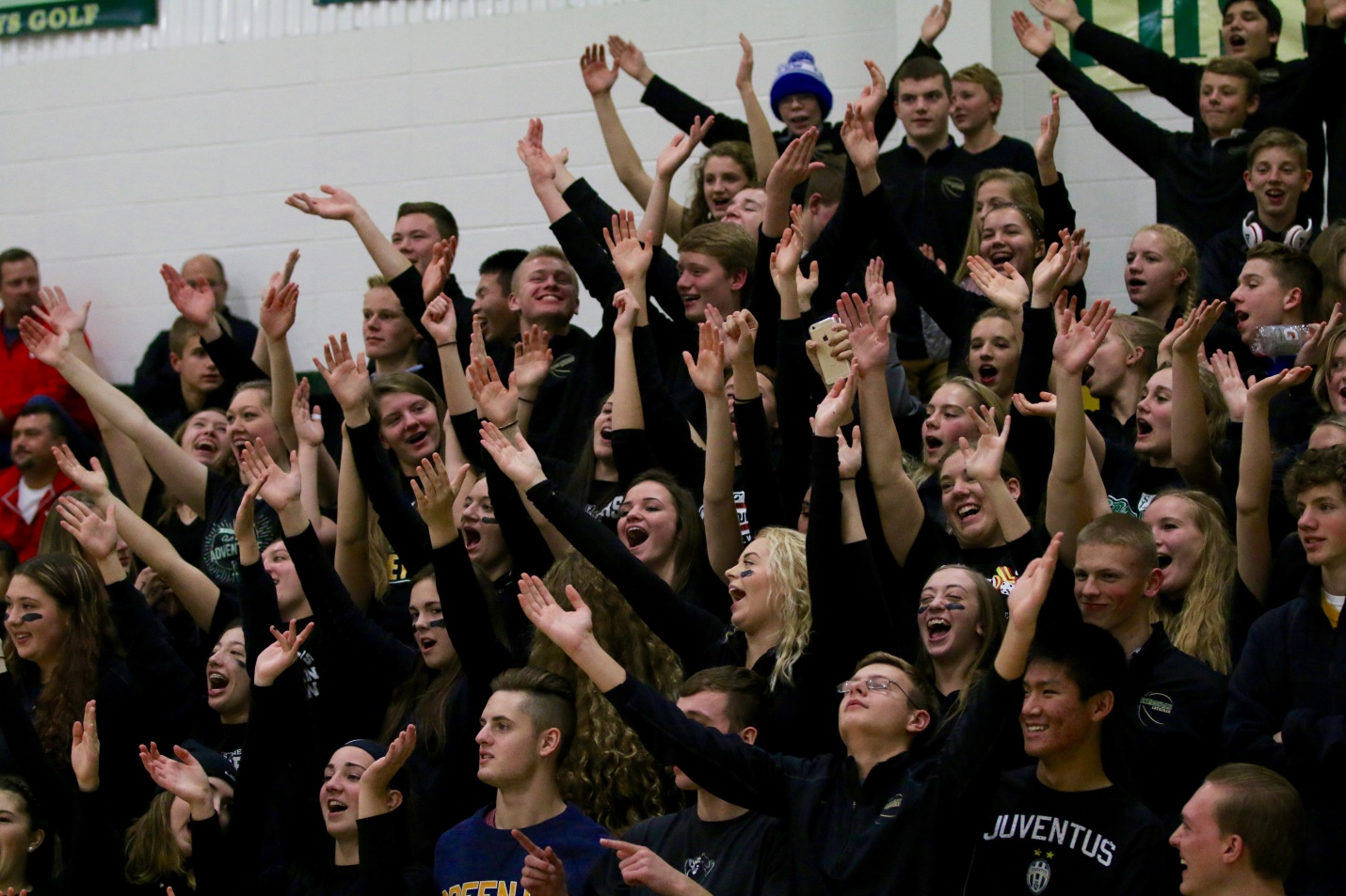 Students cheering their fellow students at a basketball game
