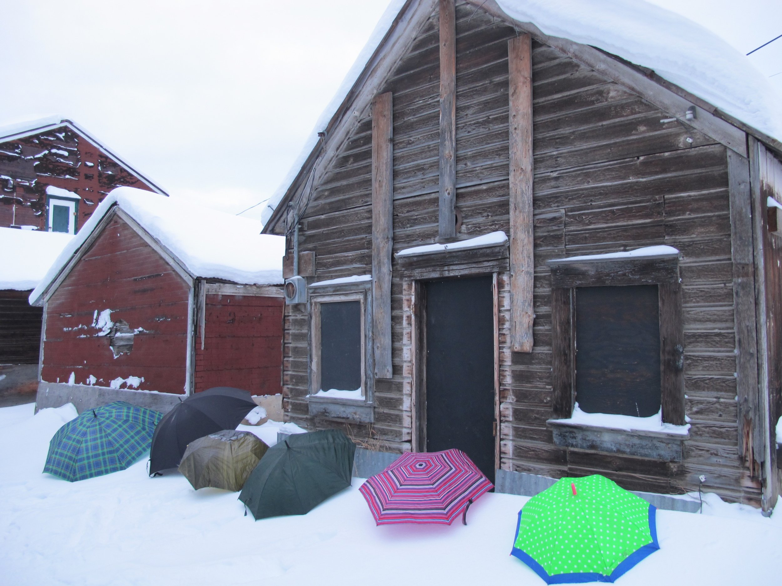 Umbrellas set up for casting with paper and ice (Dawson City, Yukon,back alley behind KIAC Klondike Institute of Art and Culture)