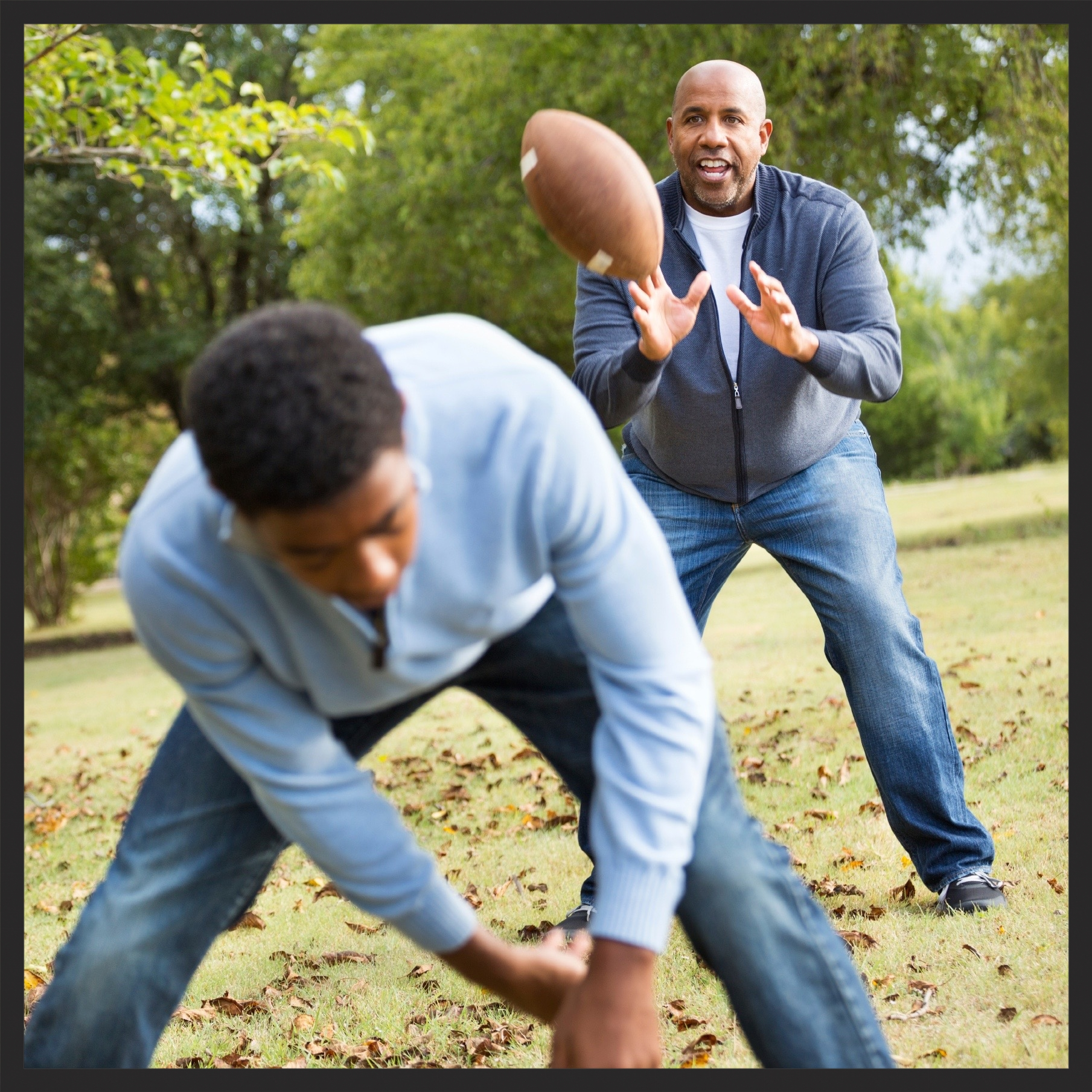 men playing football together